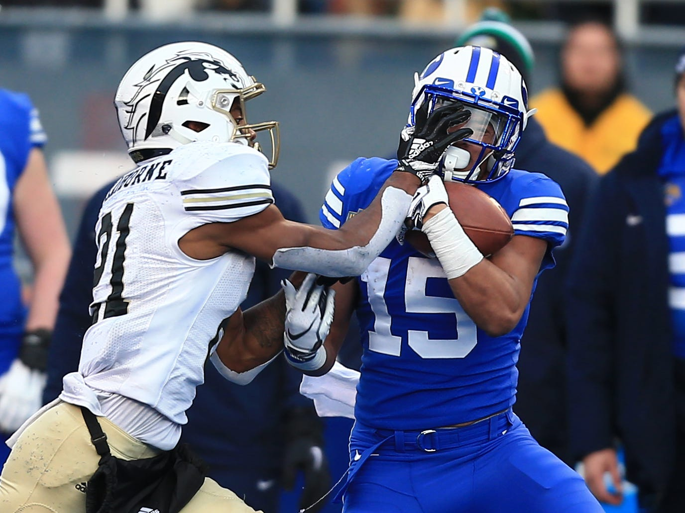 Dec 21, 2018; Boise, ID, United States; Brigham Young Cougars wide receiver Aleva Hifo (15) catches a pass against Western Michigan Broncos defensive back Stefan Claiborne (21) during the second half of the 2018 Potato Bowl at Albertsons Stadium.