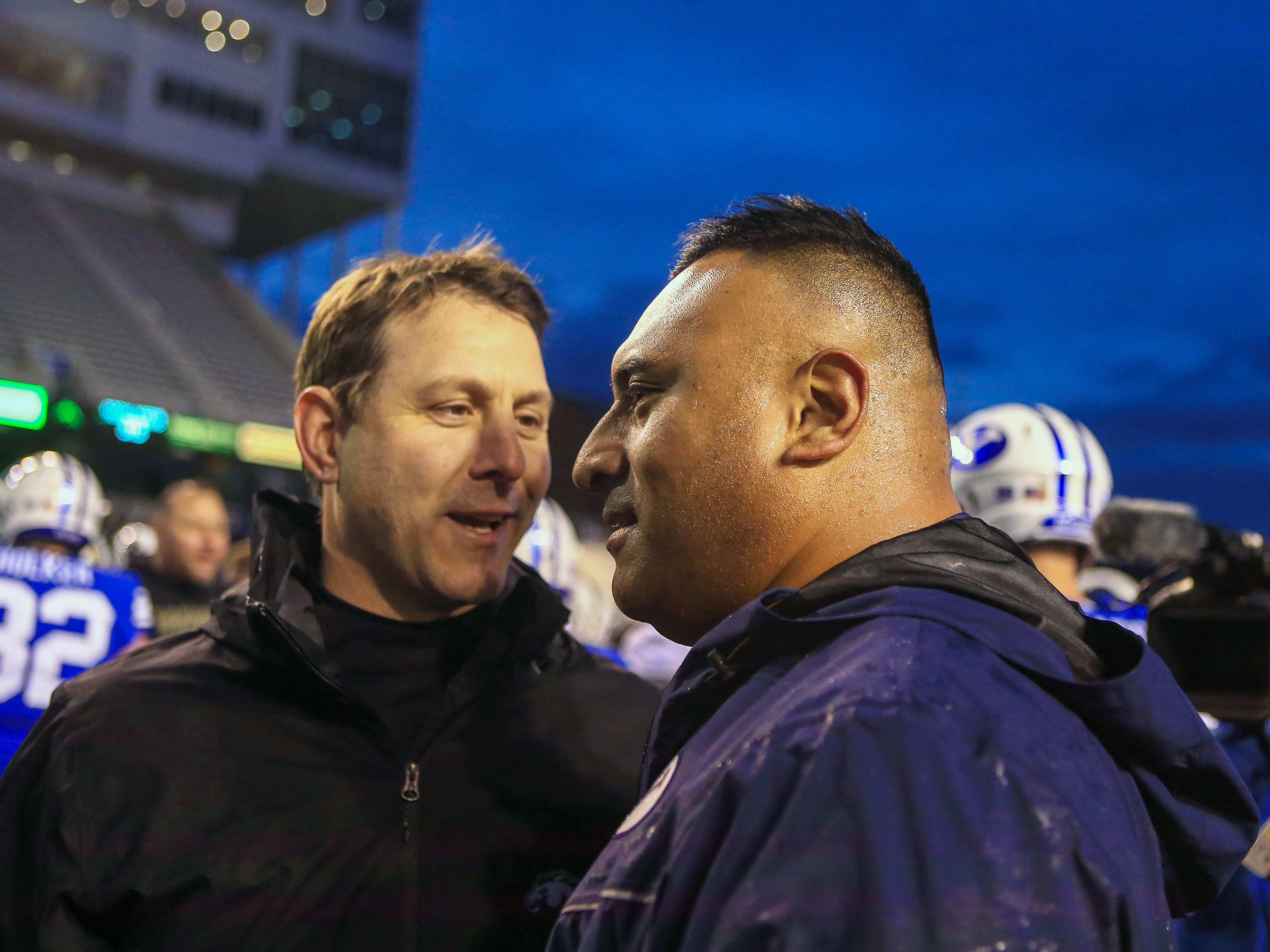 Dec 21, 2018; Boise, ID, United States; Brigham Young Cougars head coach Kalani Sitake (right) and Western Michigan Broncos head coach Tim Lester meet at midfield at the conclusion of the 2018 Potato Bowl at Albertsons Stadium. Brigham Young defeated Western Michigan 49-18.