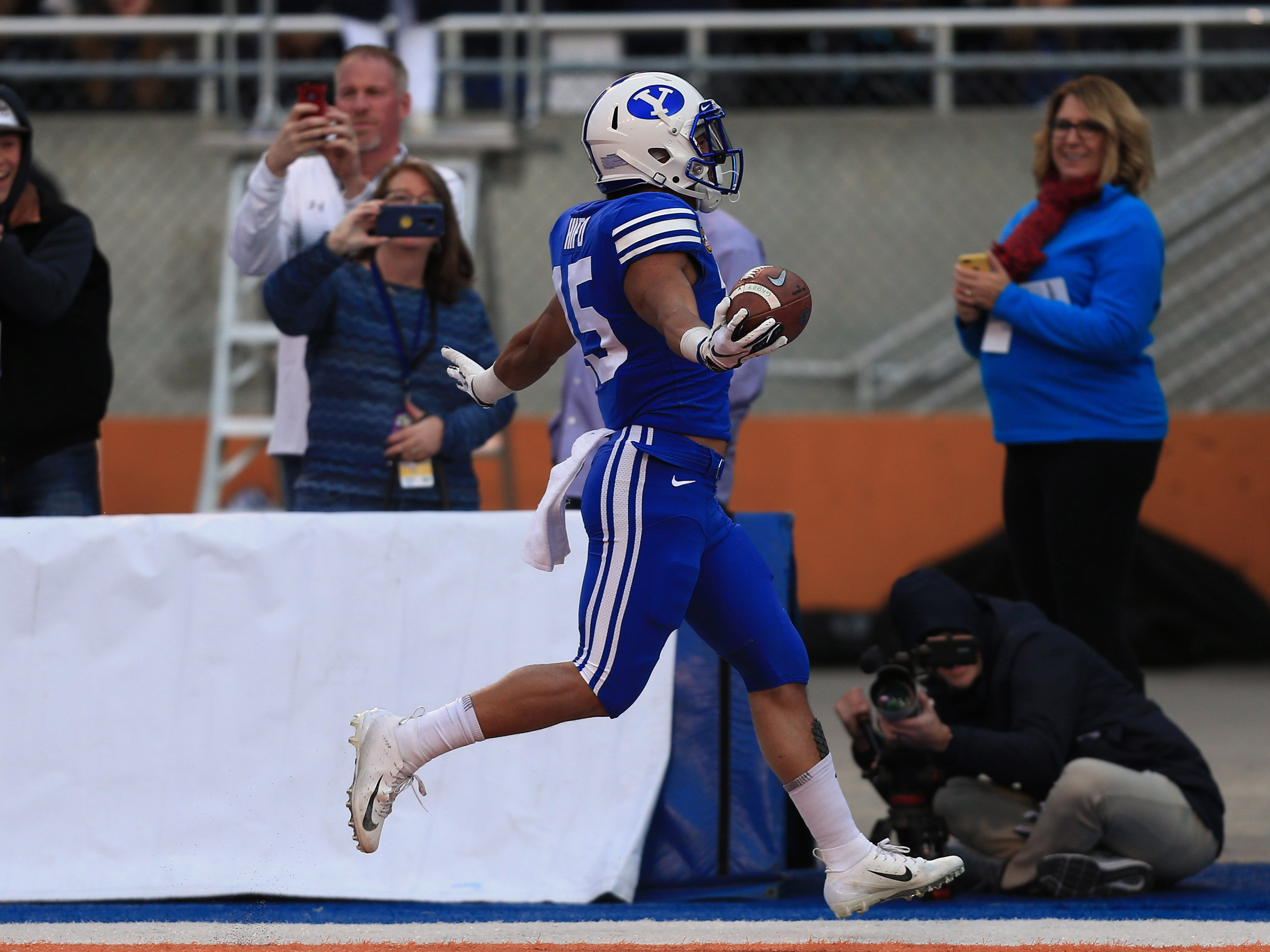 Dec 21, 2018; Boise, ID, United States; Brigham Young Cougars wide receiver Aleva Hifo (15) scores a 70-yard touchdown against the Western Michigan Broncos during the second half of the 2018 Potato Bowl at Albertsons Stadium.