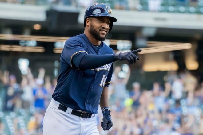 The Mariners have acquired right-handed hitting outfielder Domingo Santana from the Brewers.