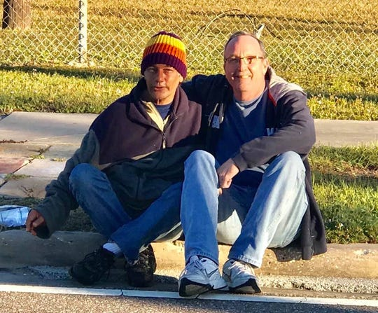 Palm Bay homeless advocate Tom Rebman (right) and a team of volunteers spent Saturday morning brightly colored beanies and care packages to 19 homeless camps in the  Palm Bay area.