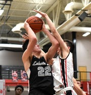 Bash Wieland (22) draws the foul and a trip to the free throw line for Lakota East, December 21, 2018.
