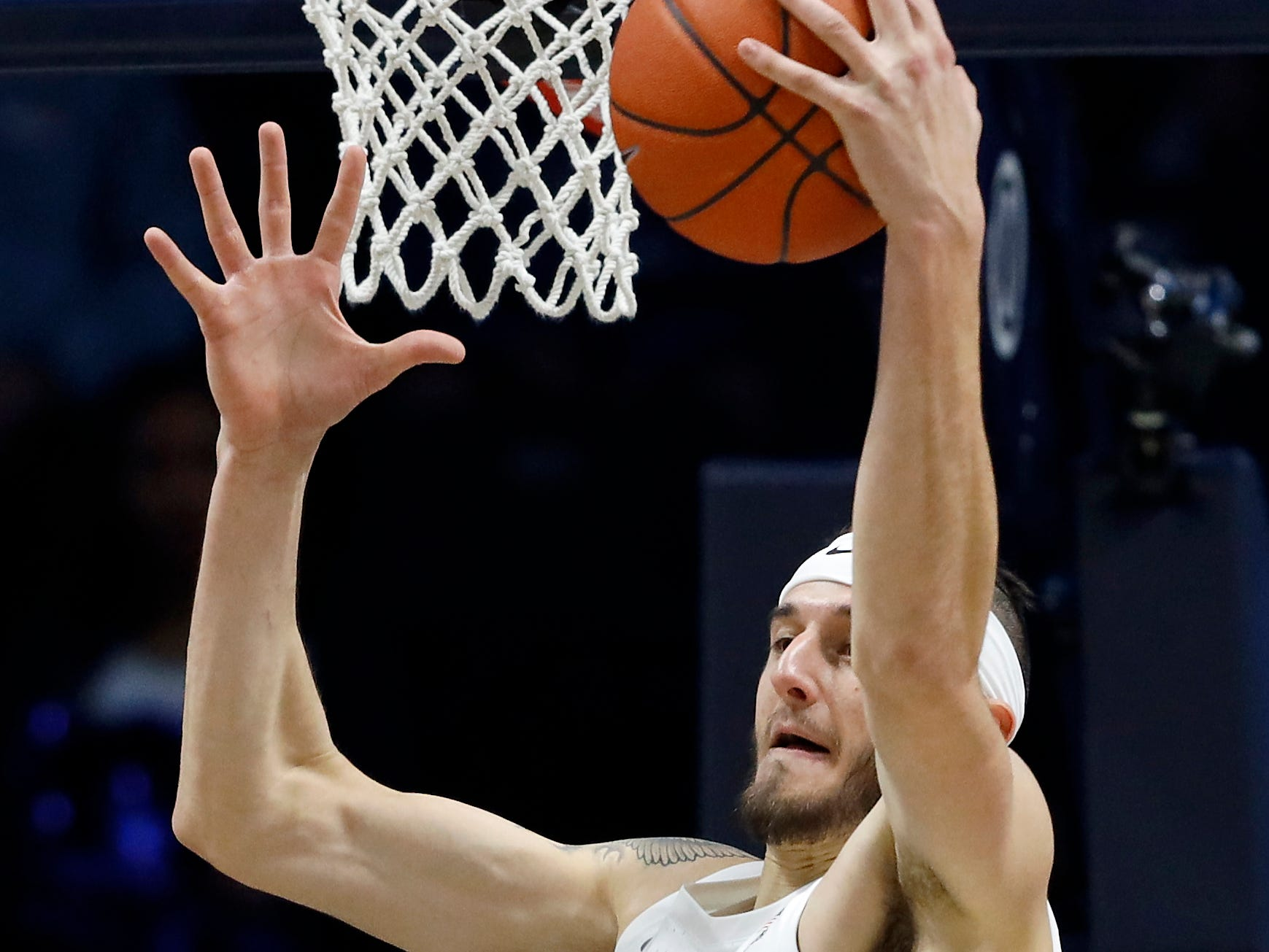 Xavier Musketeers forward Zach Hankins reaches out for a rebound in the first half of a game against Detroit Mercy at the Cintas Center on Friday.