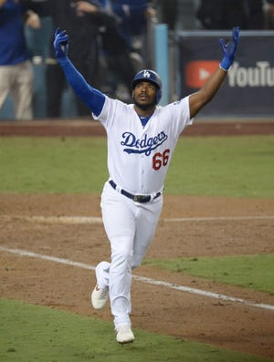Oct 27, 2018; Los Angeles, CA, USA; Los Angeles Dodgers outfielder Yasiel Puig (66) celebrates after hitting a three run home run in the sixth inning against the Boston Red Sox in game four of the 2018 World Series at Dodger Stadium. Mandatory Credit: Gary A. Vasquez-USA TODAY Sports