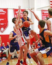 Campbell County guard Drew Wilson drives and scores from the paint. Beechwood defeated Campbell County 67-66.