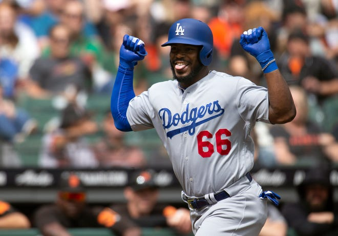 Sep 29, 2018; San Francisco, CA, USA; Los Angeles Dodgers right fielder Yasiel Puig (66) celebrates his solo home run against the San Francisco Giants during the second inning of a Major League Baseball game at AT&T Park. Mandatory Credit: D. Ross Cameron-USA TODAY Sports