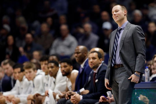Xavier Musketeers head coach Travis Steele reacts after his team gives up a rebound in the first half.