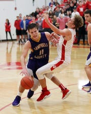 Beechwood's C.J. Brannen draws a game-changing charge against Campbell County's Reid Jolly in the final seconds of the Boys Basketball game between the Campbell County Camels and the Beechwood Tigers. Beechwood defeated Campbell County 67-66.