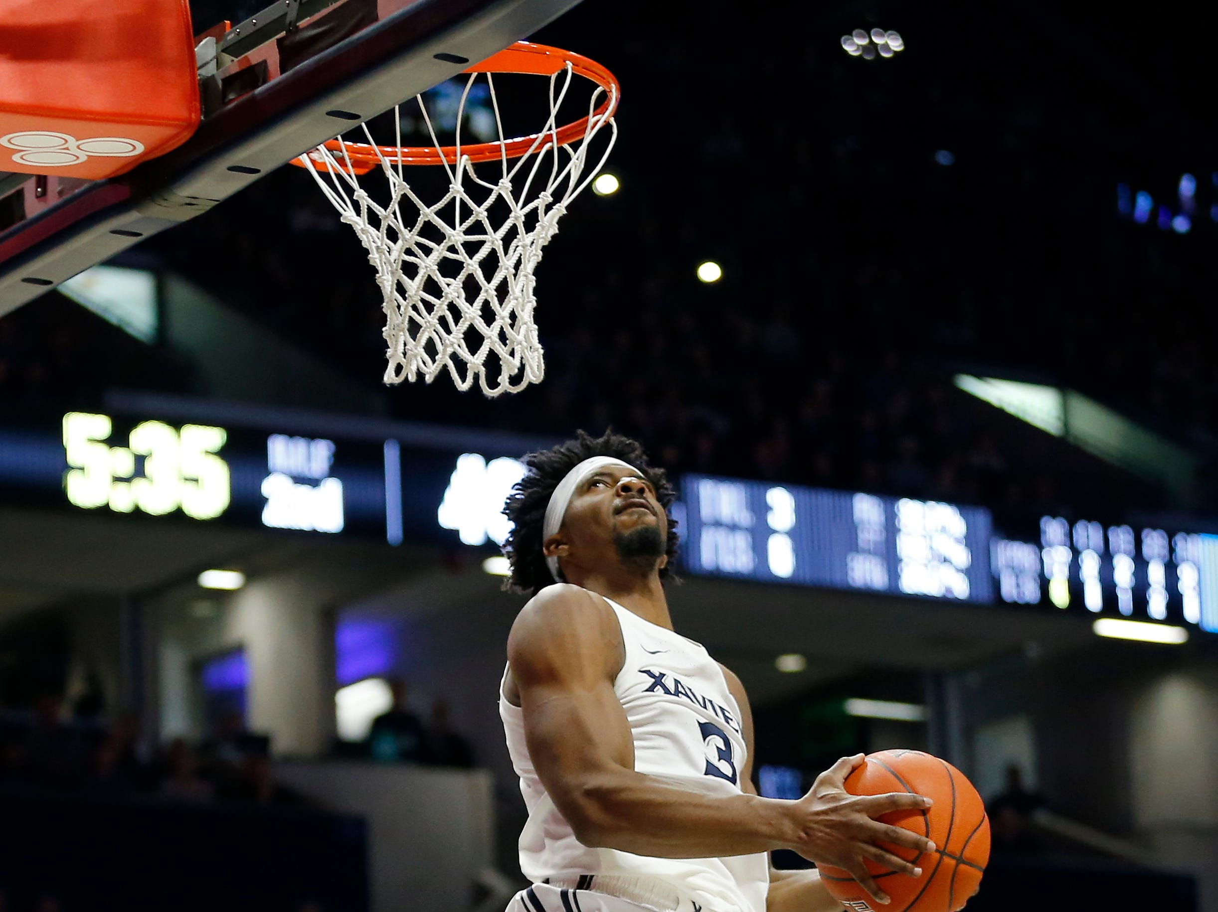 Xavier Musketeers guard Quentin Goodin goes up for a reverse dunk in the second half.
