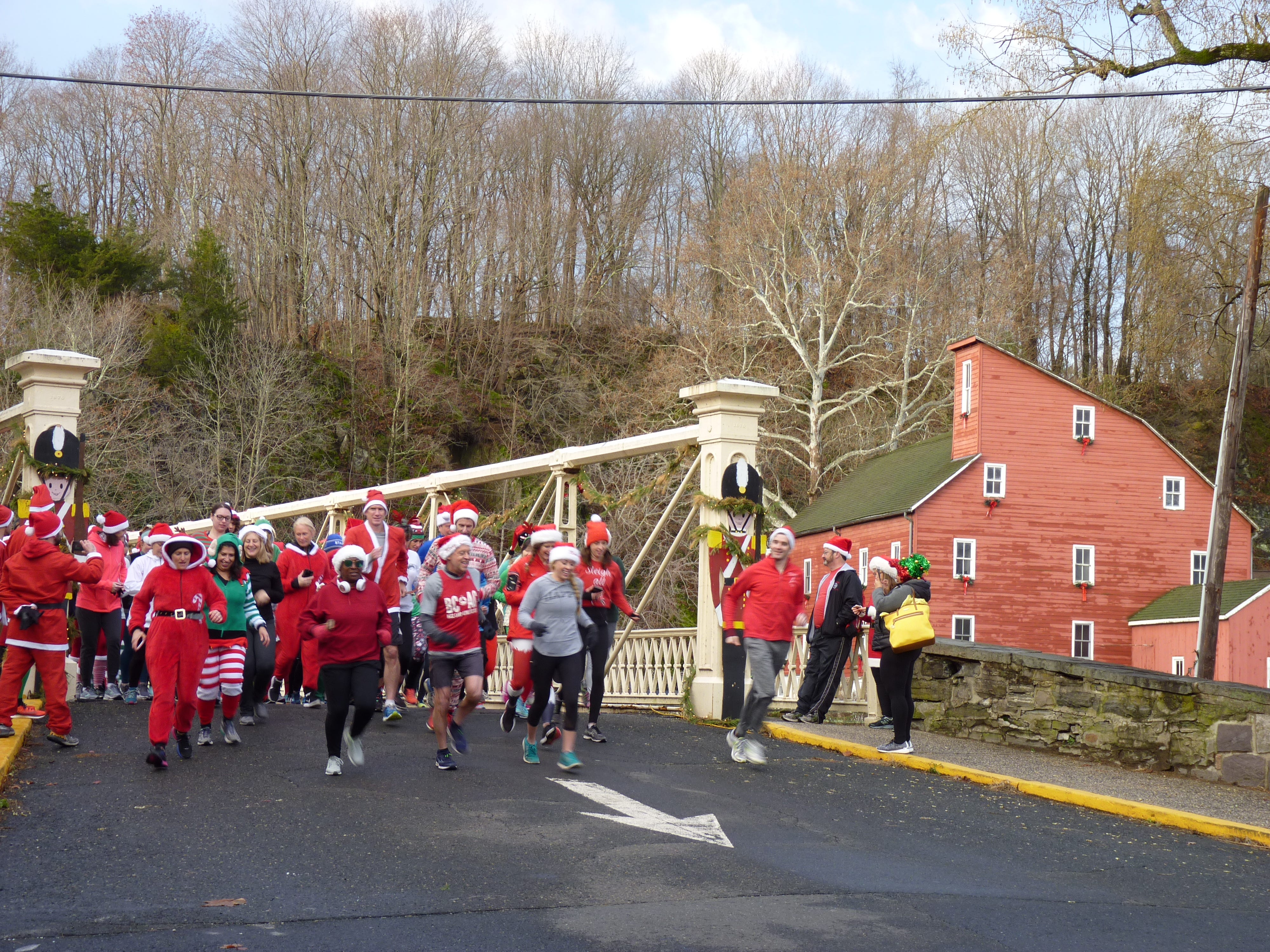 "More than 1,000 people came out to Clinton on Saturday, Dec. 22 dressed in festive costumes to run in the ""Run Before Christmas"" SantaCon 8K race to raise funds for the Red Mill Museum Village."