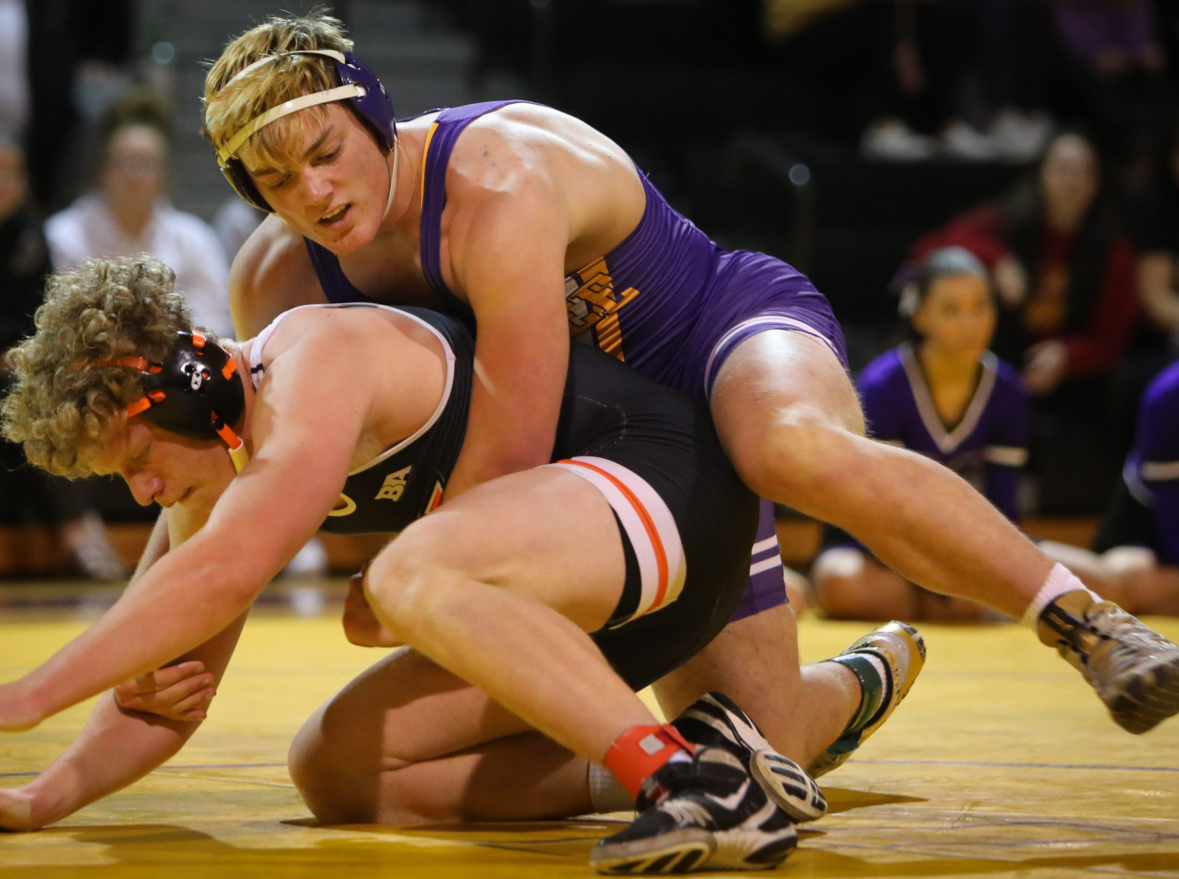 Waukee junior Cael Thorson wrestles Valley senior Bracken Cobb during a high school wrestling meet between the Valley Tigers and the Waukee Warriors at Waukee High School on Dec. 20, 2018 in Waukee, Iowa.