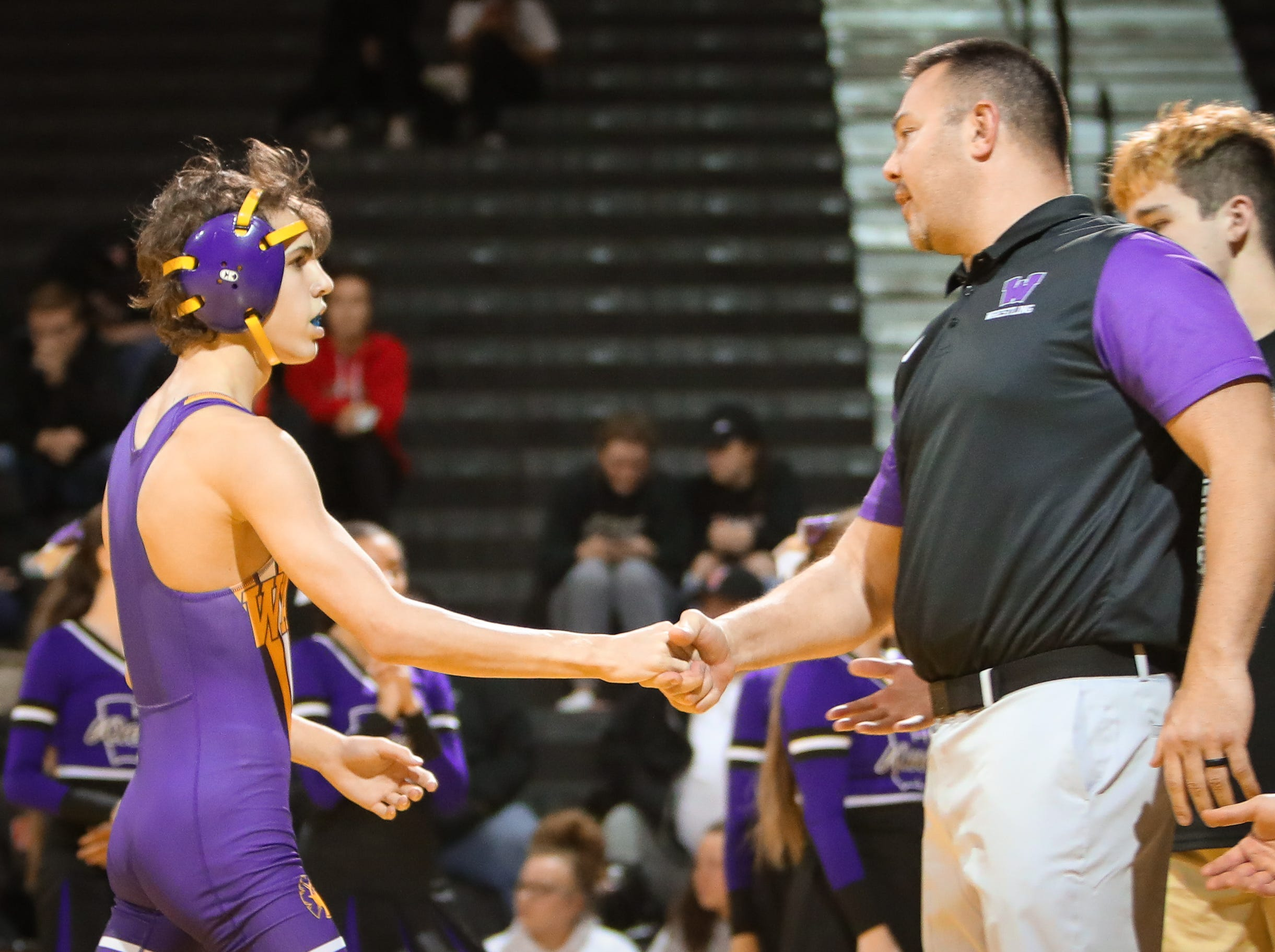 Waukee sophomore Connor Kellely celebrates with head coach Chad Vollmecke after winning the 106-pound weight class during a high school wrestling meet between the Valley Tigers and the Waukee Warriors at Waukee High School on Dec. 20, 2018 in Waukee, Iowa.