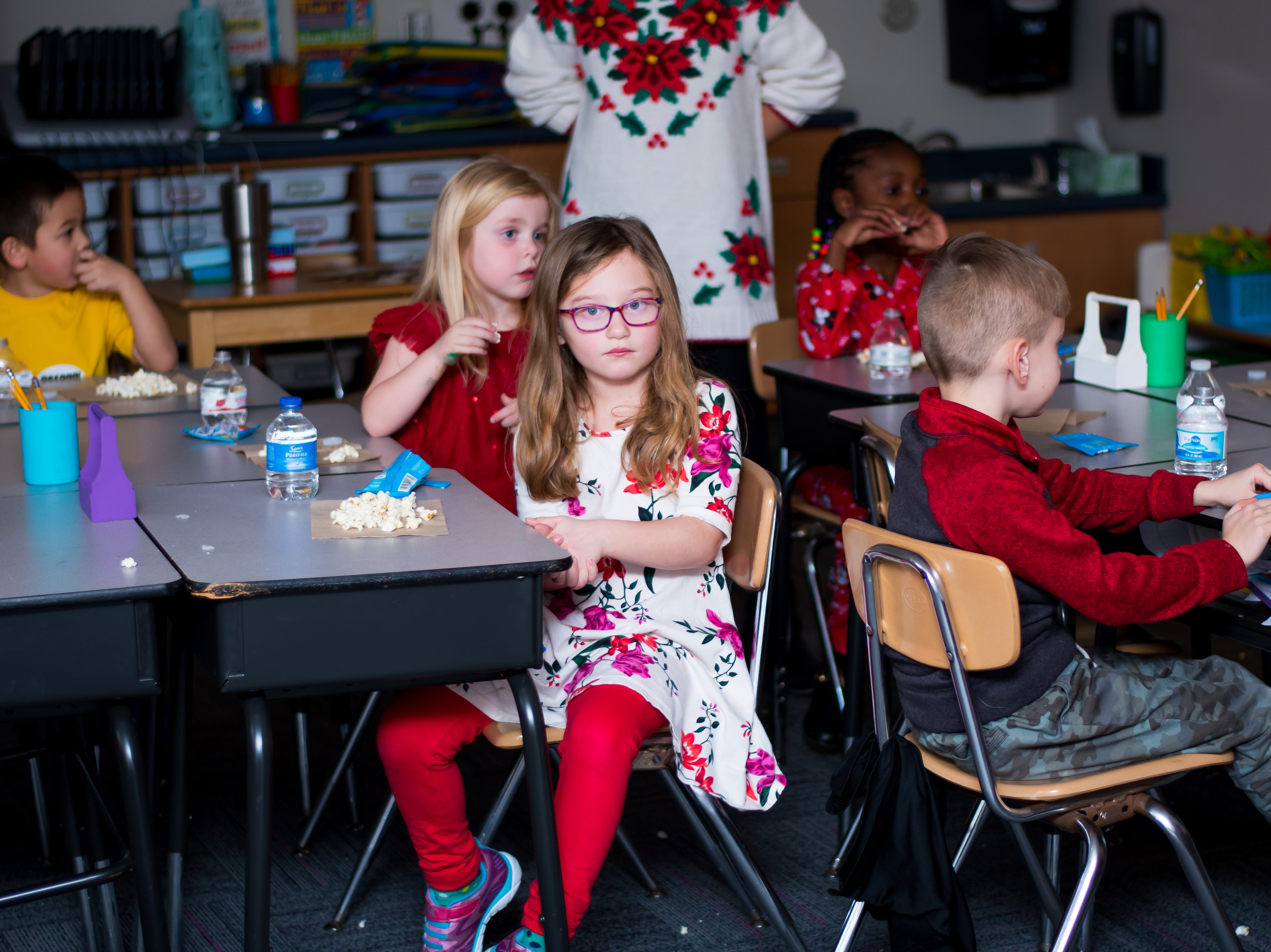 Students enjoy a snack and a Christmas movie on Friday, Dec. 21, 2018 at Karen Acres Elementary School in Urbandale for their winter party.