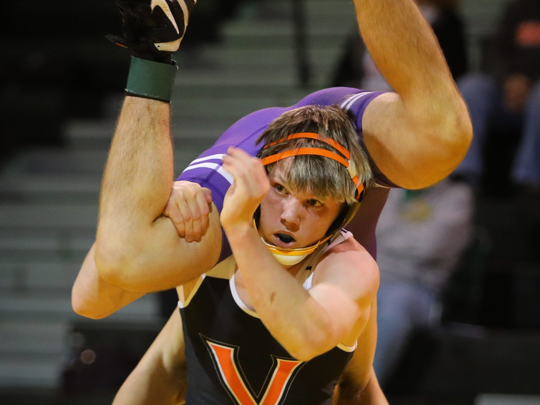 Valley freshman Caleb Corbin wrestles Waukee senior Mason Seifried in the 152-weight class during a high school wrestling meet between the Valley Tigers and the Waukee Warriors at Waukee High School on Dec. 20, 2018 in Waukee, Iowa.