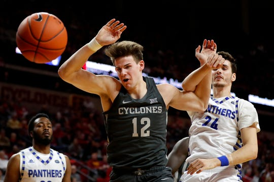 Iowa State forward Michael Jacobson (12) competes for a rebound with Eastern Illinois forward Rade Kukobat, right, during the second half of an NCAA college basketball game Friday, Dec. 21, 2018, in Ames, Iowa.