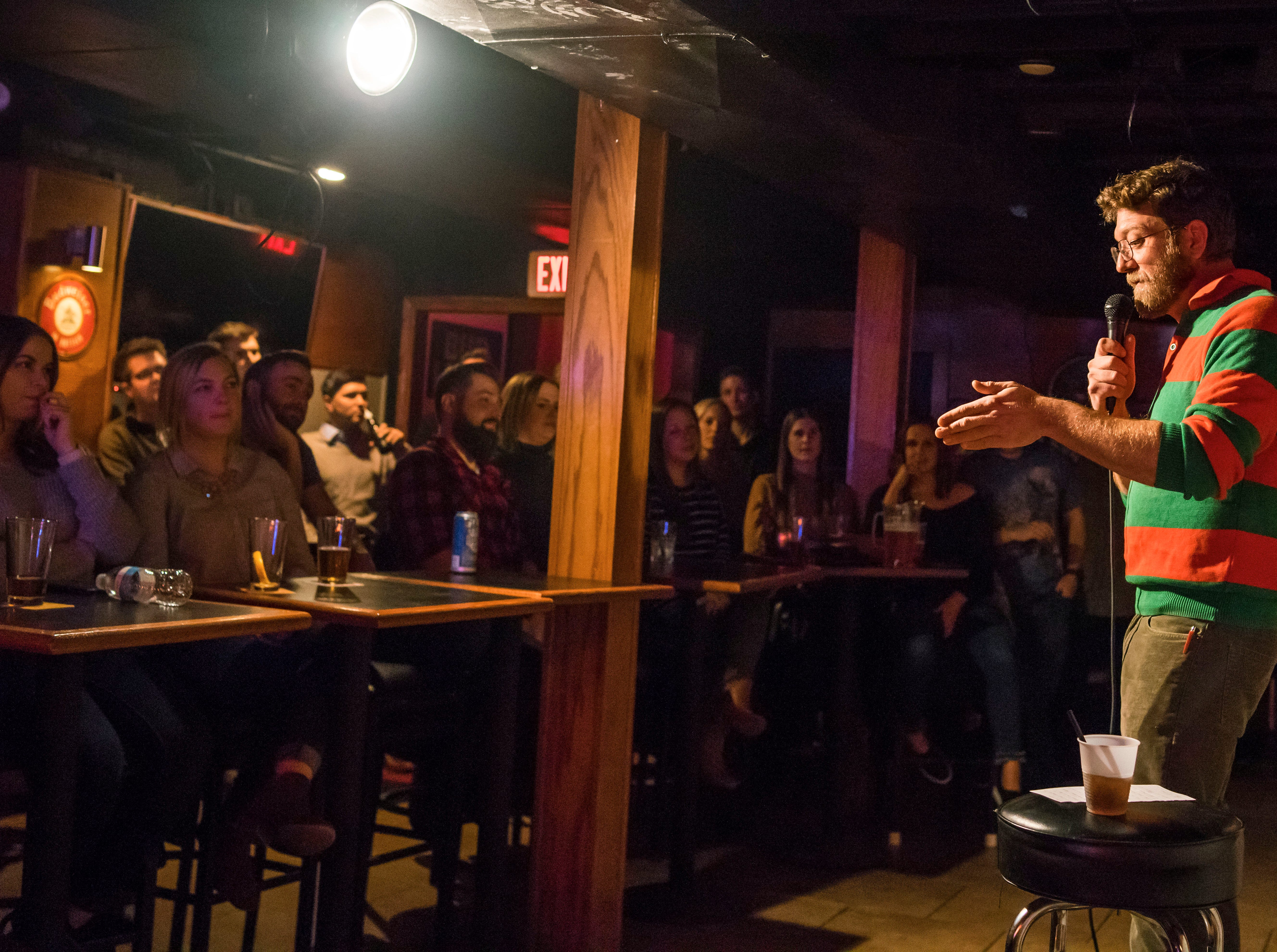 Toll McGrane, 37, of Des Moines, performing stand up comedy, Friday, Dec. 21, at the Bomb Shelter Comedy Showcase, hosted by the Beechwood.