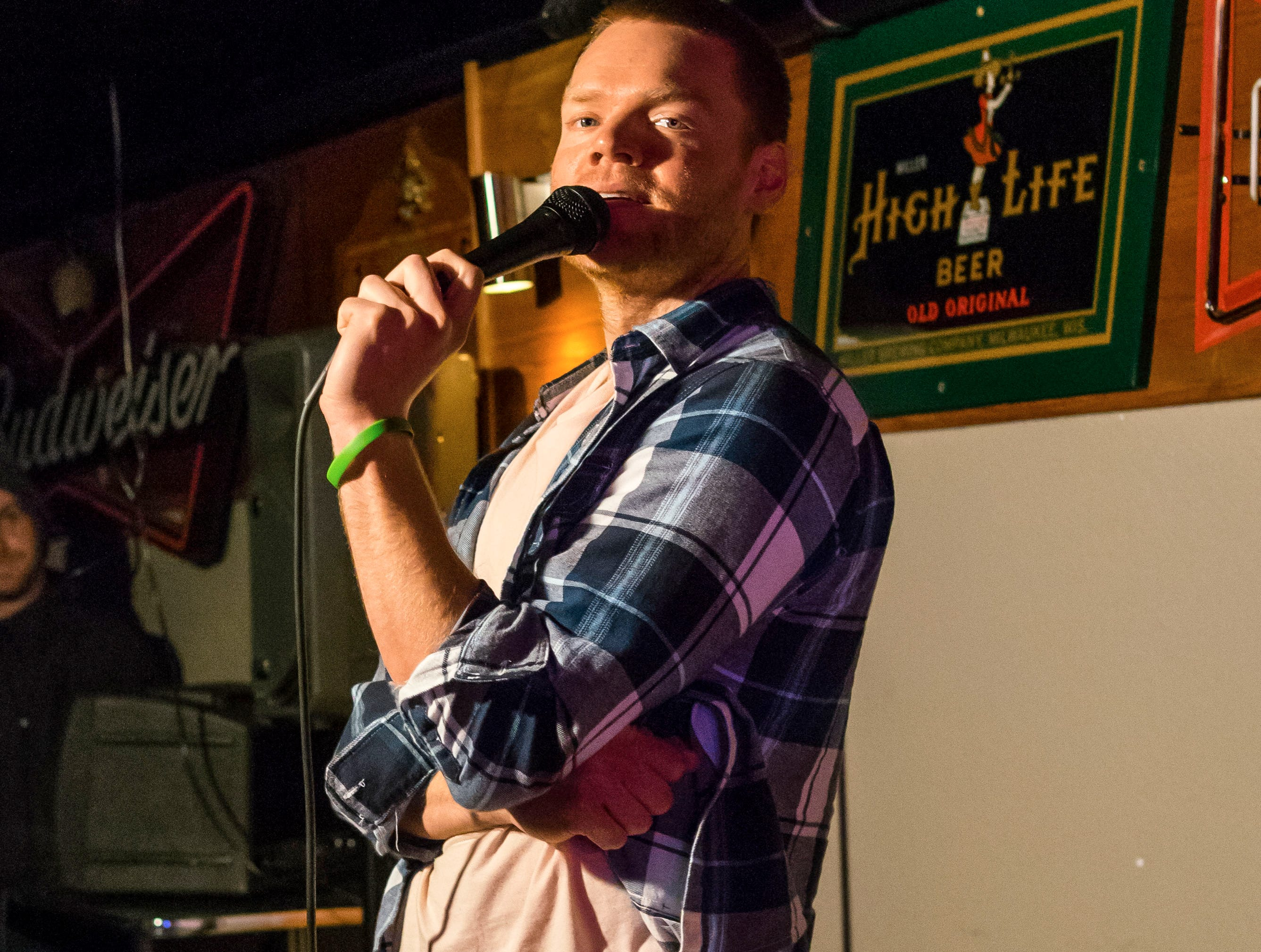 Lucas Hirl, 33, of Los Angeles, performing stand up comedy, Friday, Dec. 21, at the Bomb Shelter Comedy Showcase, hosted by the Beechwood.