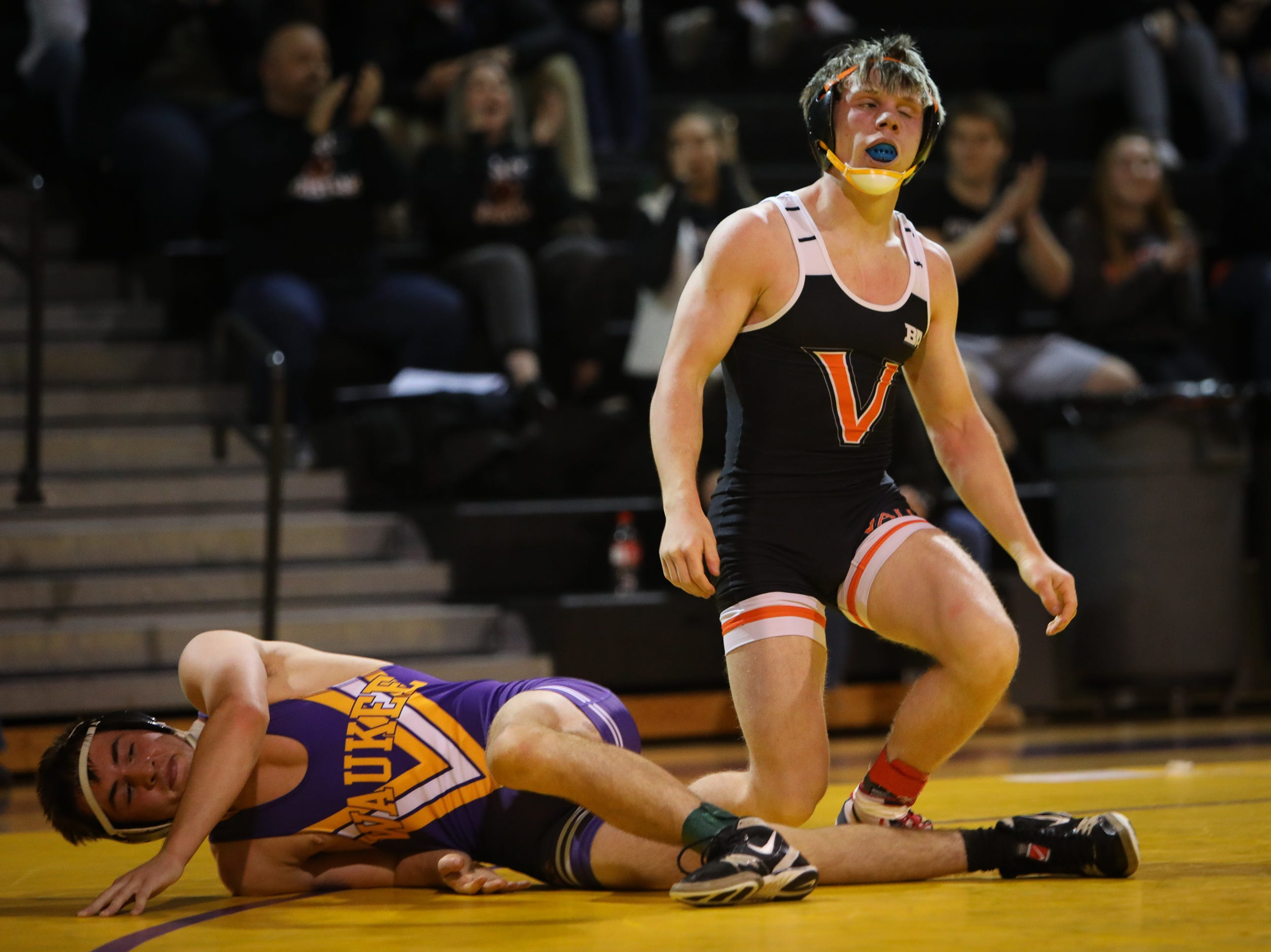 Valley freshman Caleb Corbin emerges victorious over Waukee senior Mason Seifried in the 152-weight class during a high school wrestling meet between the Valley Tigers and the Waukee Warriors at Waukee High School on Dec. 20, 2018 in Waukee, Iowa.