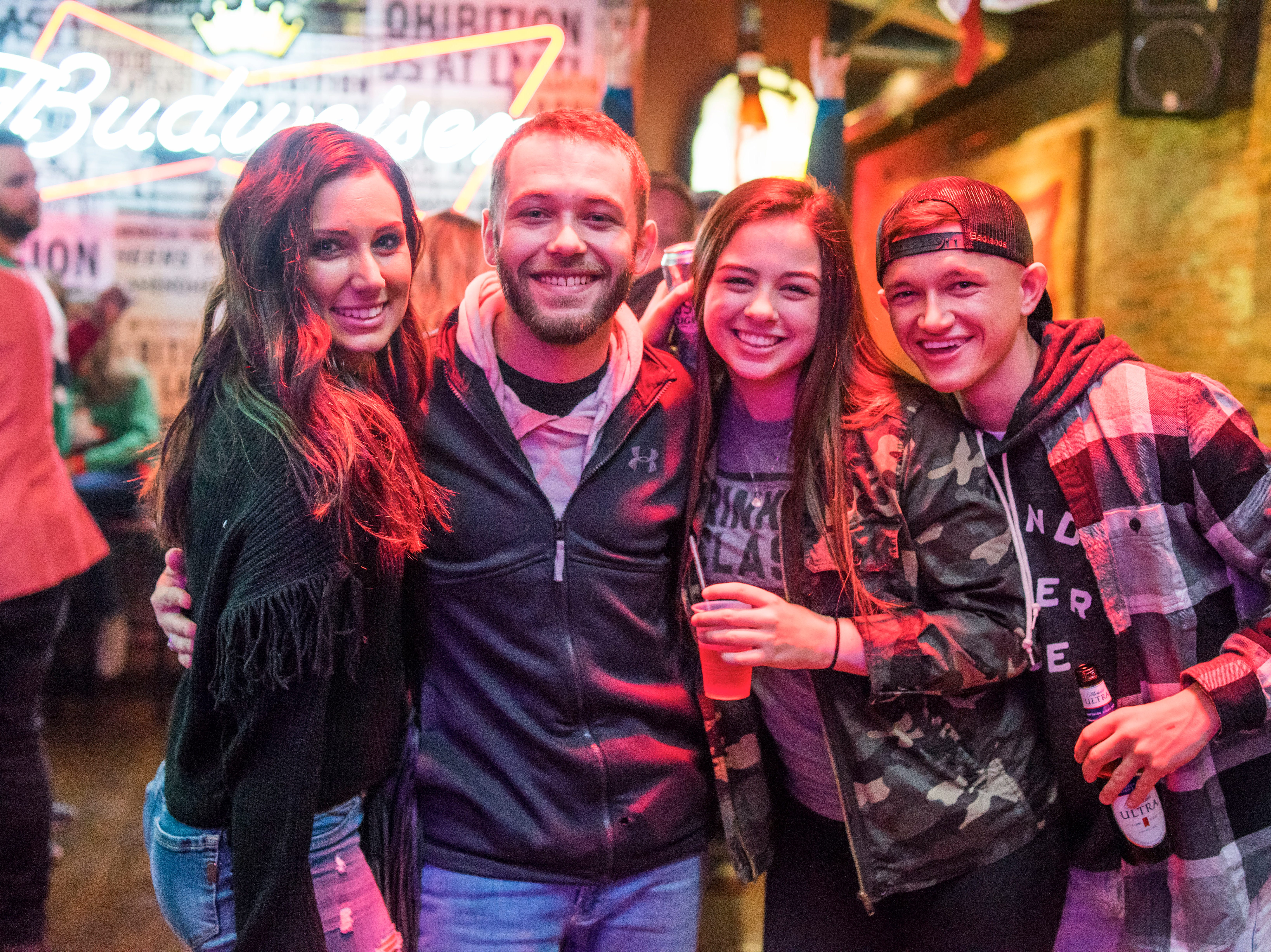 Mandy Johnson, 24, Wade Mahlstadt, 24, Taryn Swartz, 22, and Matt Johnson, 23, all of Des Moines, enjoying their night out, Friday, Dec. 21, at American Outlaws.