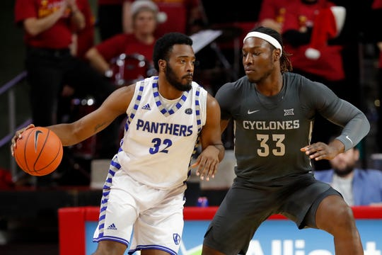 Eastern Illinois forward JaQualis Matlock is defended by Iowa State forward Solomon Young, right, during the second half of an NCAA college basketball game Friday, Dec. 21, 2018, in Ames, Iowa. Iowa State won 101-53.