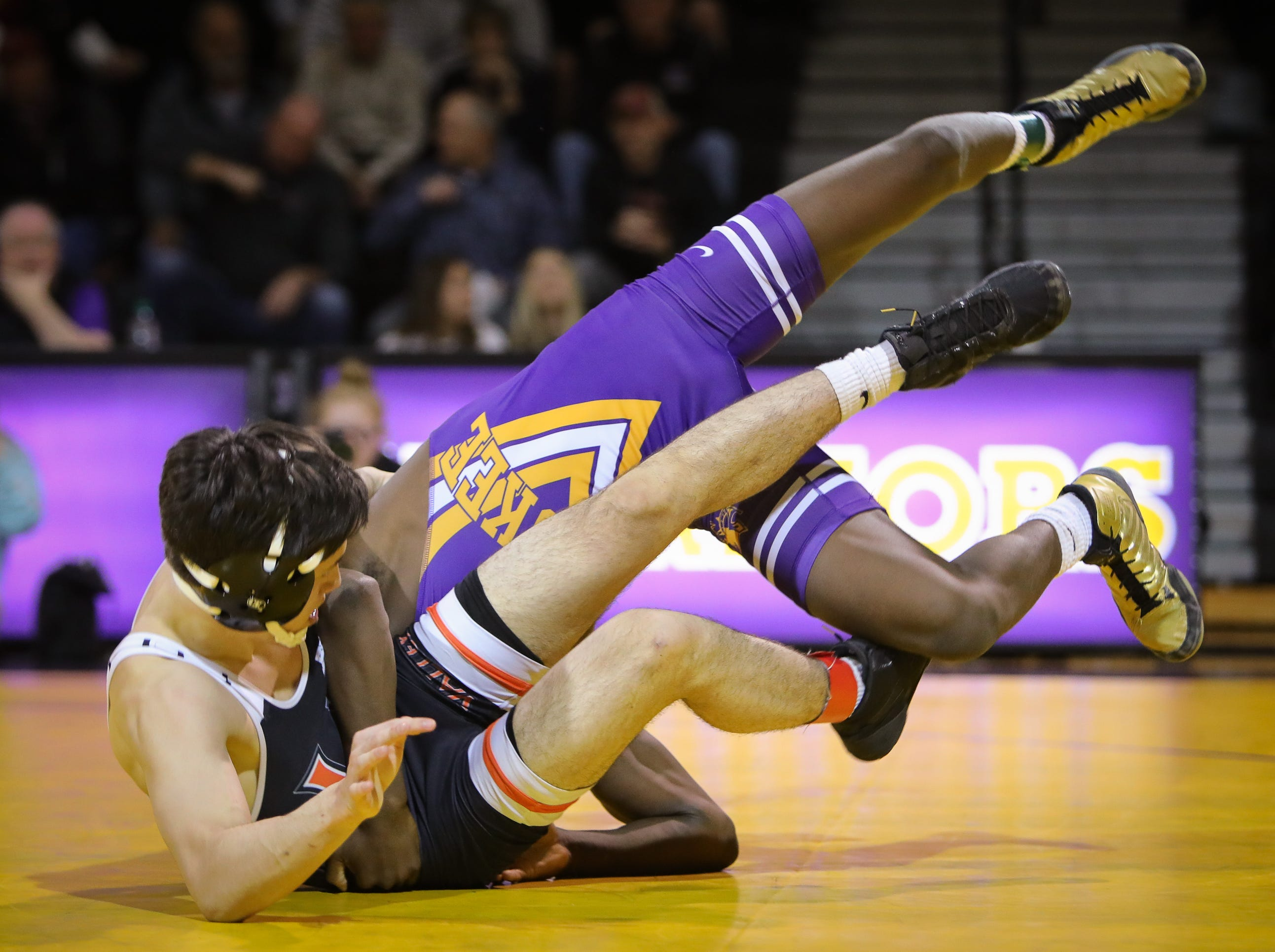 Valley senior Jackson Lukehart wrestles Waukee sophomore Jermaine Sammler in the 145-pound weight class during a high school wrestling meet between the Valley Tigers and the Waukee Warriors at Waukee High School on Dec. 20, 2018 in Waukee, Iowa.