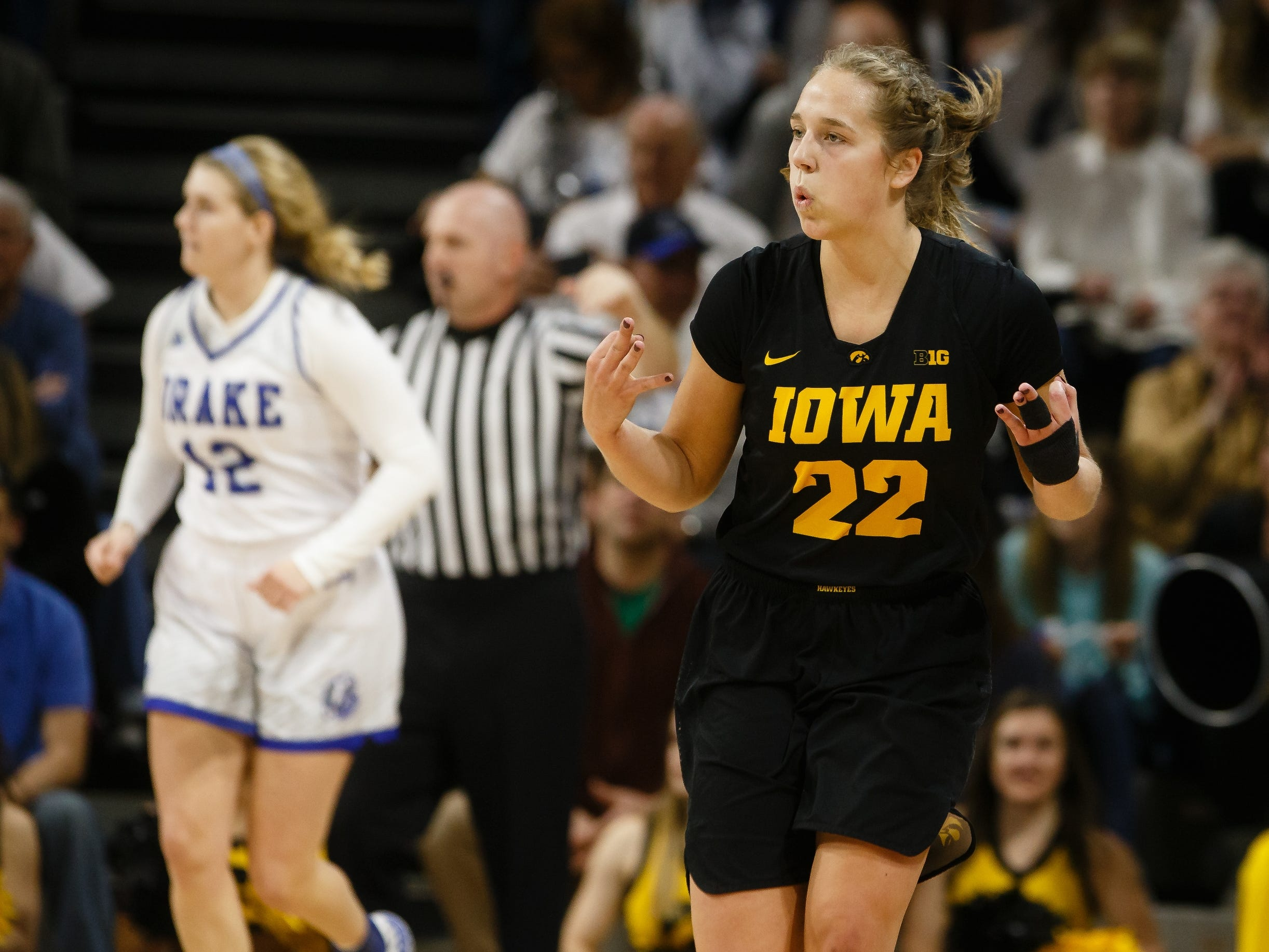 Iowa's Kathleen Doyle (22) celebrates a three-point shot during their basketball game on Friday, Dec. 21, 2018, in Des Moines. Drake takes a 45-43 lead into halftime.