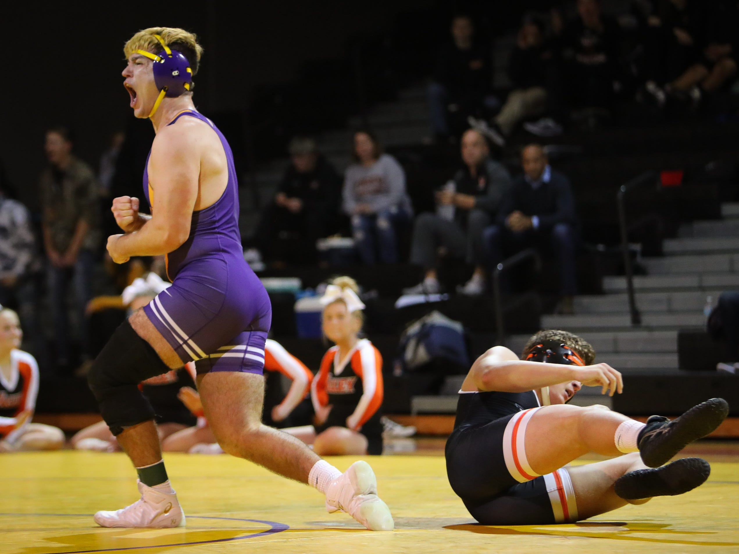 Waukee senior Gabe Gammell celebrates after recording a comeback victory over Valley junior C.J. Stillman in the 195-pound weight class during a high school wrestling meet between the Valley Tigers and the Waukee Warriors at Waukee High School on Dec. 20, 2018 in Waukee, Iowa.