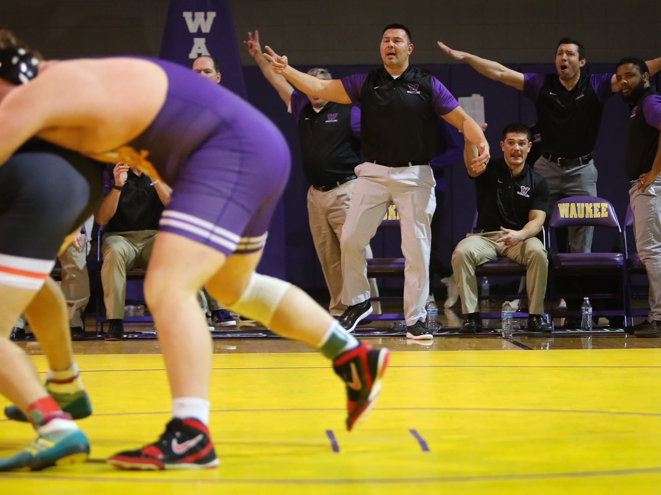 The Waukee coaching staff disagrees with a call during a high school wrestling meet between the Valley Tigers and the Waukee Warriors at Waukee High School on Dec. 20, 2018 in Waukee, Iowa.