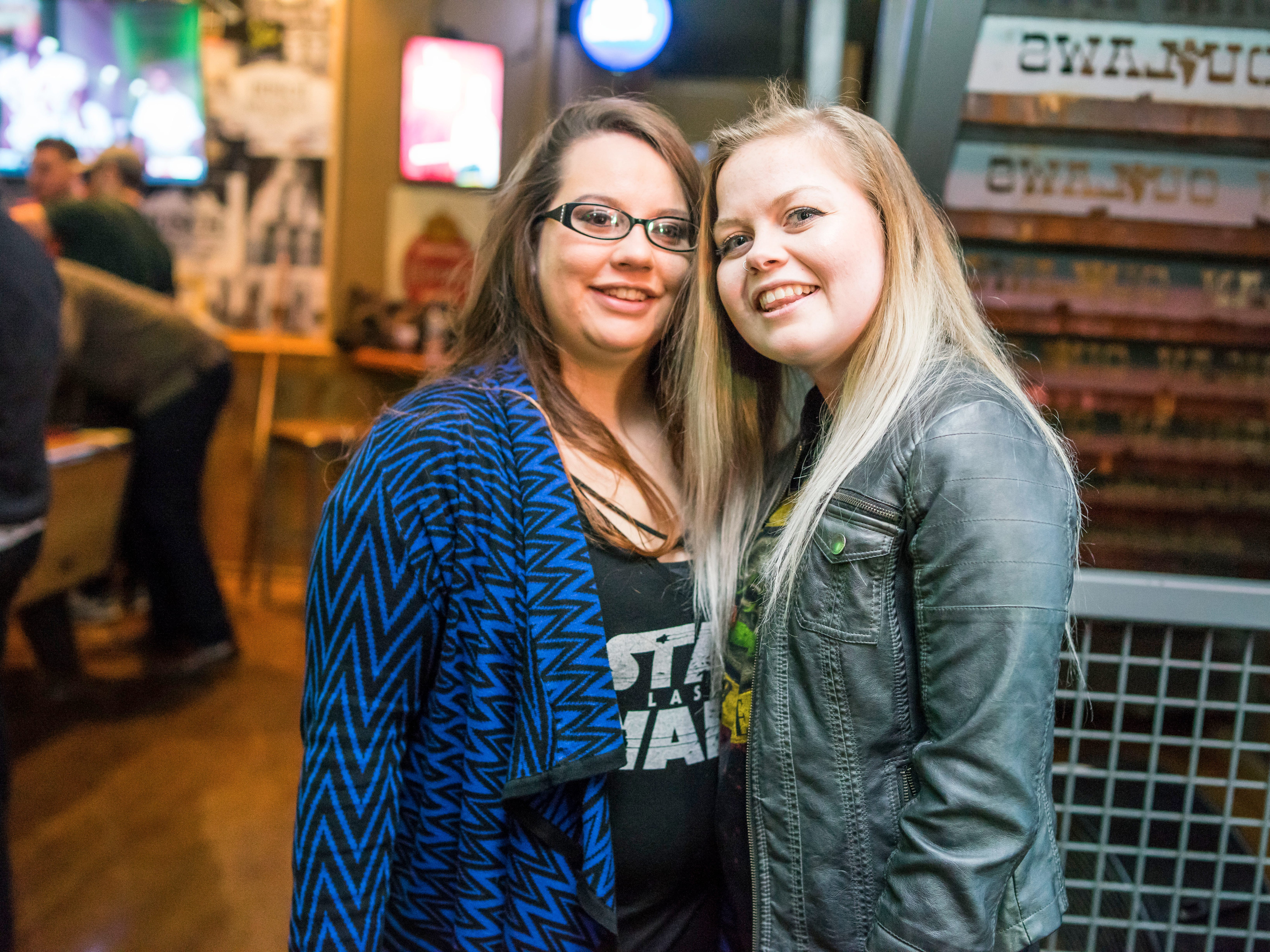 Mary Holmes, 23, and Brianna Ticcani, 22, having a fun night out, Friday, Dec. 21, at American Outlaws.