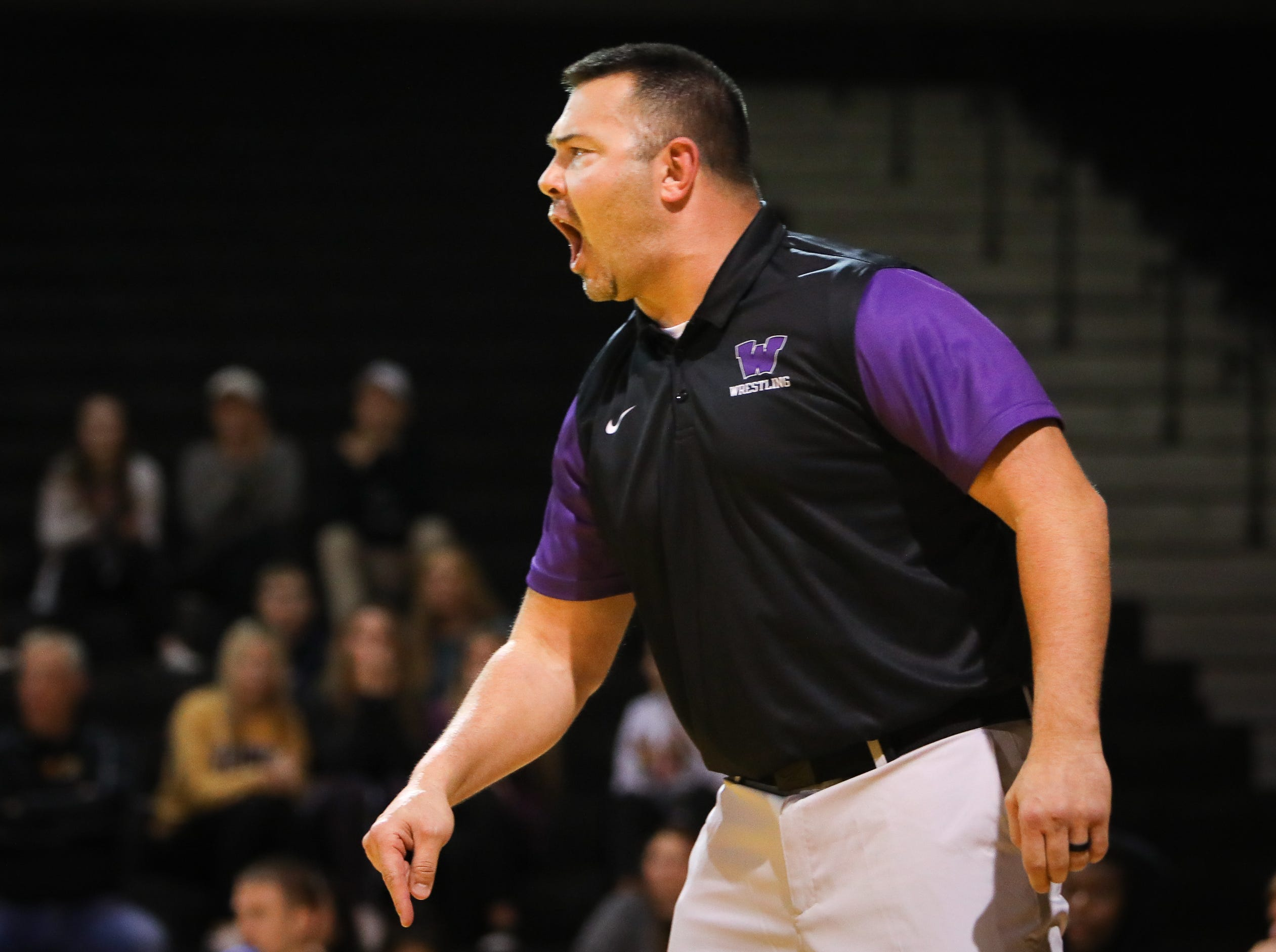 Waukee head coach Chad Vollmecke yells out instructions to his wrestlers during a high school wrestling meet between the Valley Tigers and the Waukee Warriors at Waukee High School on Dec. 20, 2018 in Waukee, Iowa.