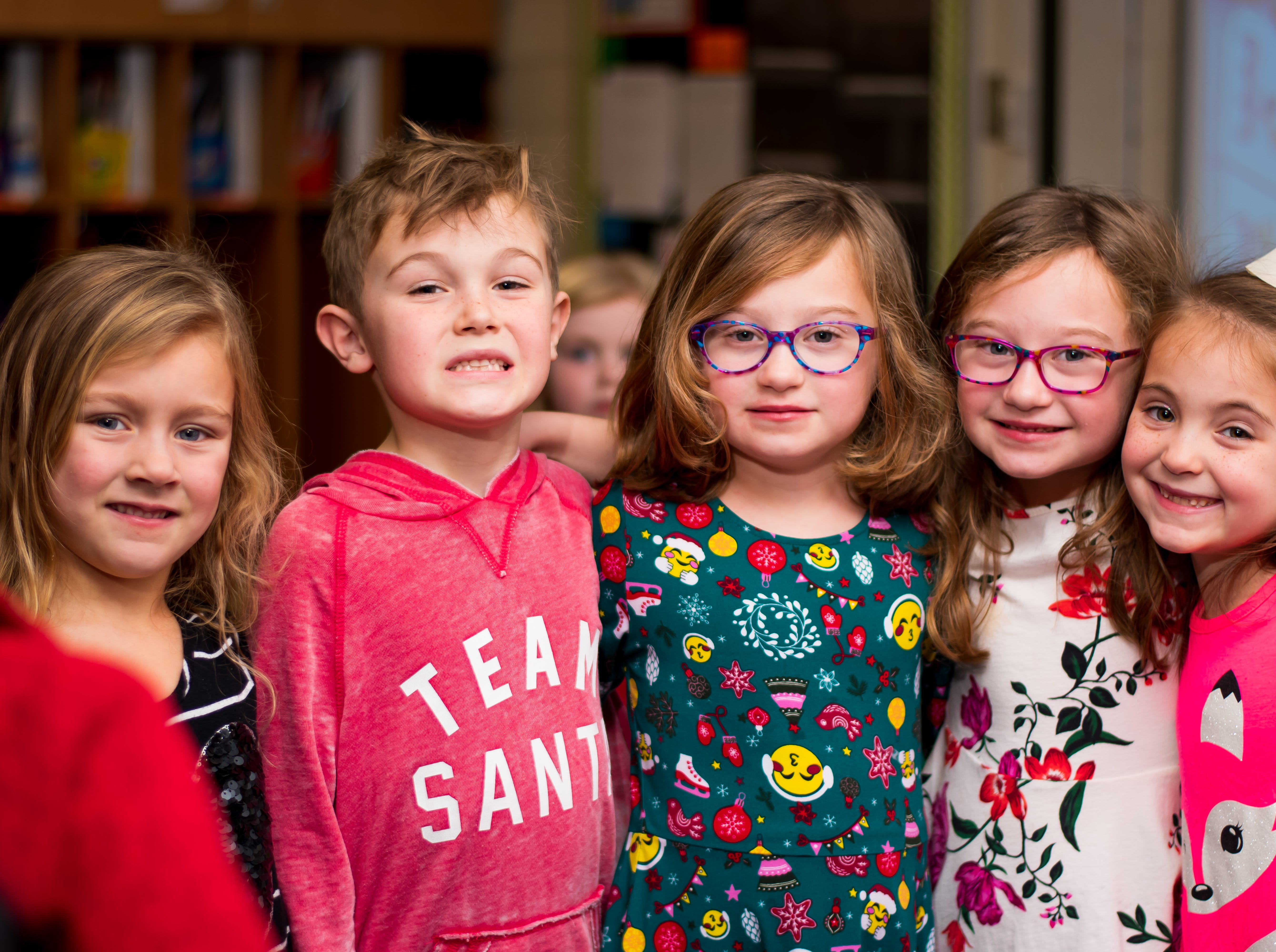 Ivy Fox, 6, Brexton Ross, 6, Evelyn Olson, 6, Allison Olson, 6, and Izabella Bieghler, 6, all of Urbandale enjoy a snack and a Christmas movie on Friday, Dec. 21, 2018 at Karen Acres Elementary School in Urbandale for their winter party.