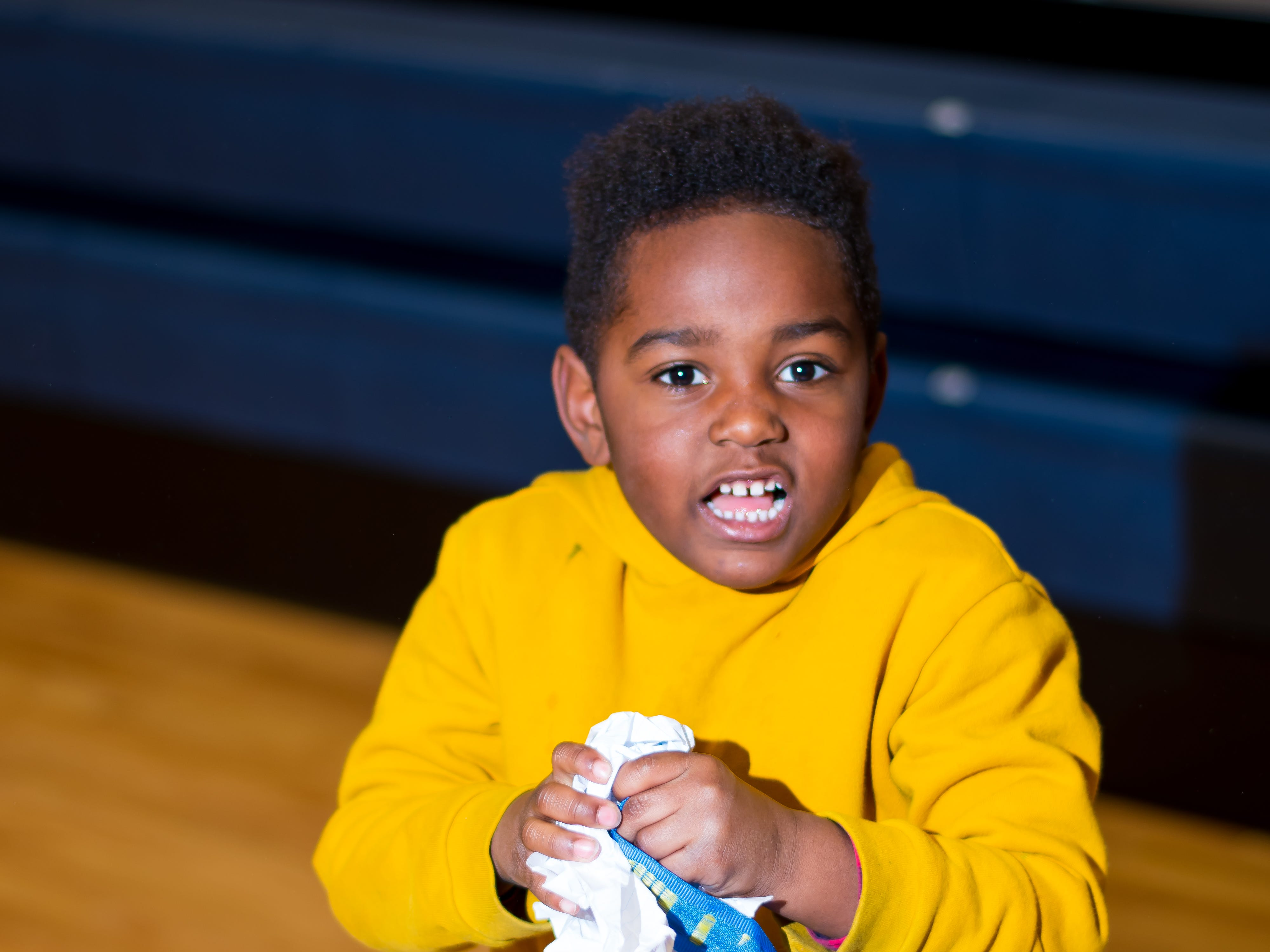 Tyshawn Clyce, 5, of Urbandale plays a snowball game on Friday, Dec. 21, 2018 at Karen Acres Elementary School in Urbandale for their winter party.