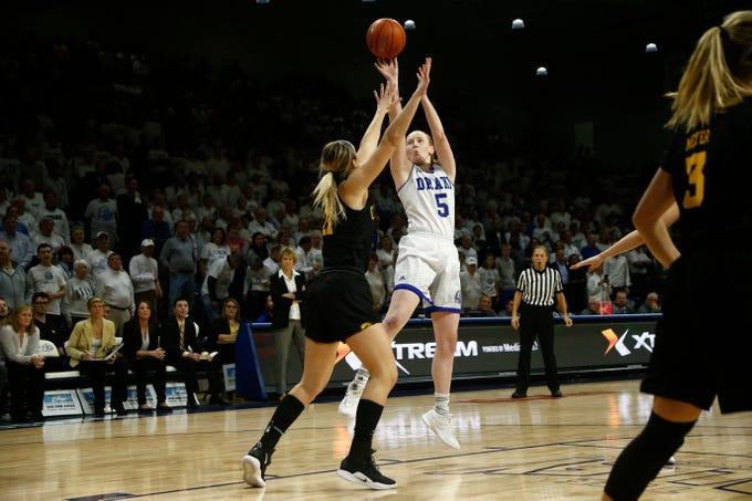 Drake's BeccaHittner (5)shoots over Iowa's Hannah Stewart (21) during their basketball game on Friday, Dec. 21, 2018, in Des Moines. Drake takes a 45-43 lead into halftime.