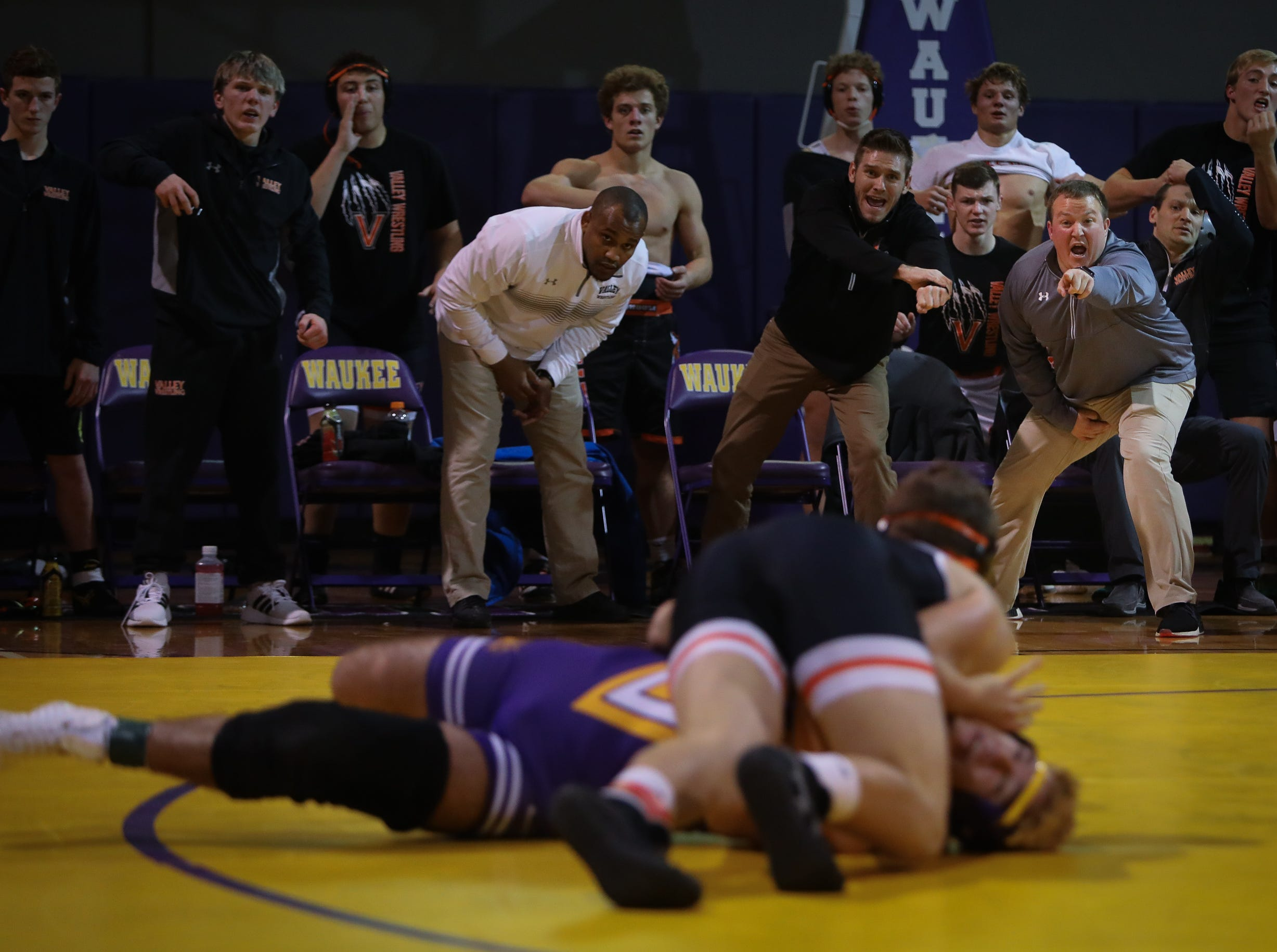 The Valley coaching staff yells out instructions to their wrestler during a high school wrestling meet between the Valley Tigers and the Waukee Warriors at Waukee High School on Dec. 20, 2018 in Waukee, Iowa.