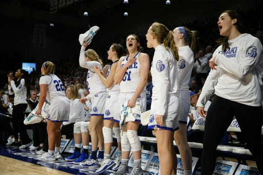 The Drake bench celebrates during their basketball game on Friday, Dec. 21, 2018, in Des Moines. Iowa would go on to defeat Drake 91-82.