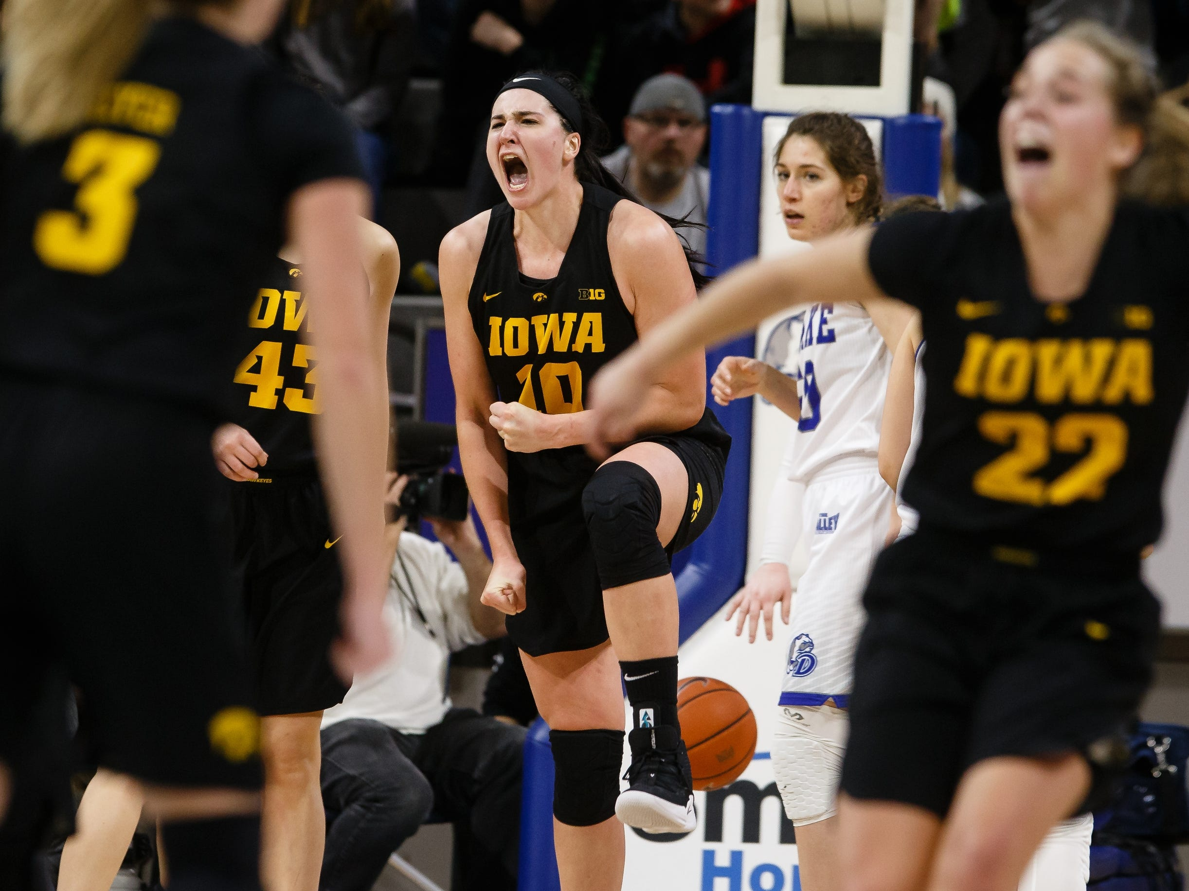 Iowa's Megan Gustafson (10) and Iowa's Kathleen Doyle (22) celebrate a basket during their basketball game on Friday, Dec. 21, 2018, in Des Moines. Iowa would go on to defeat Drake 91-82.