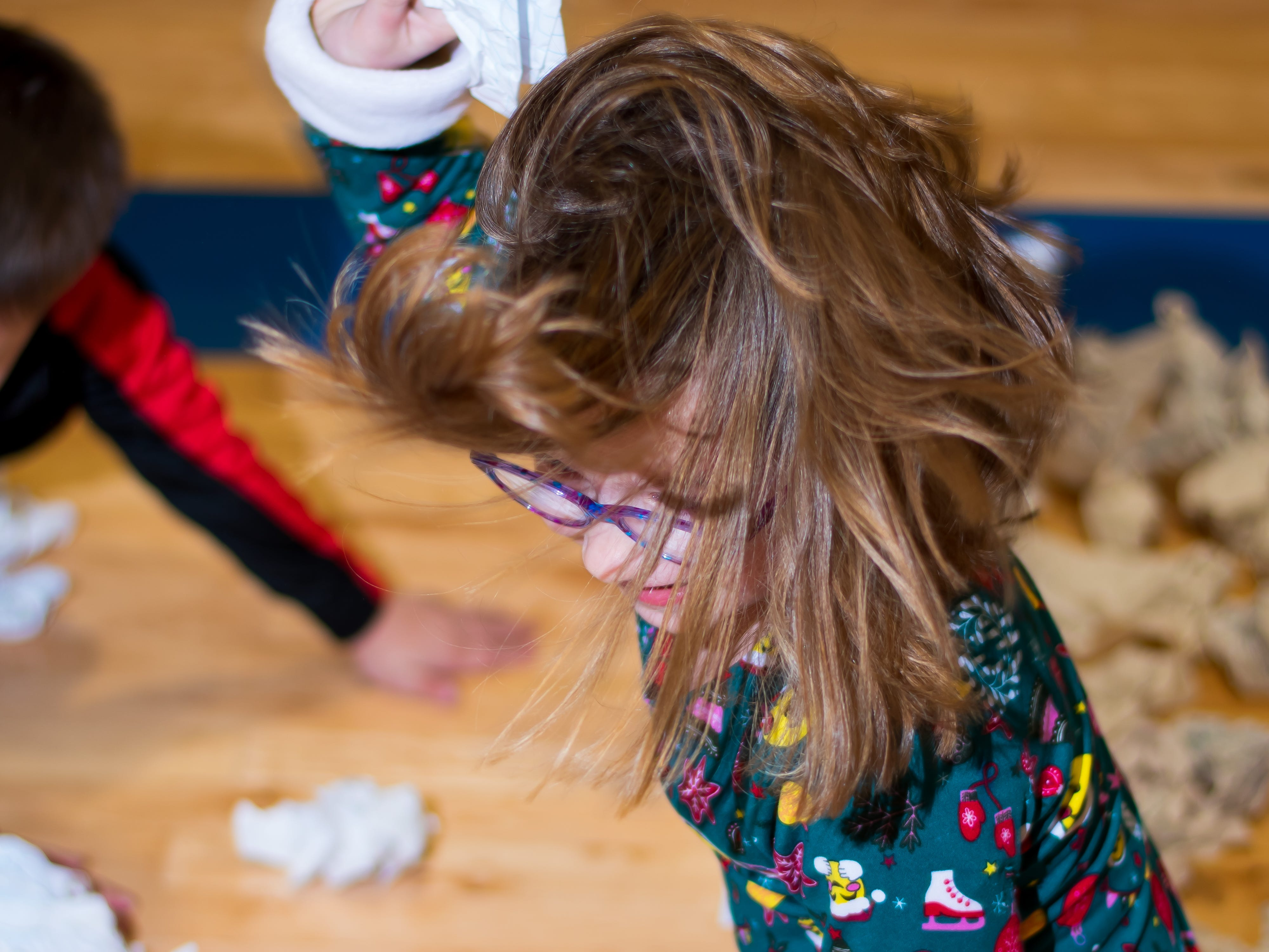 Evelyn Olson, 6, of Urbandale plays a snowball game on Friday, Dec. 21, 2018 at Karen Acres Elementary School in Urbandale for their winter party.