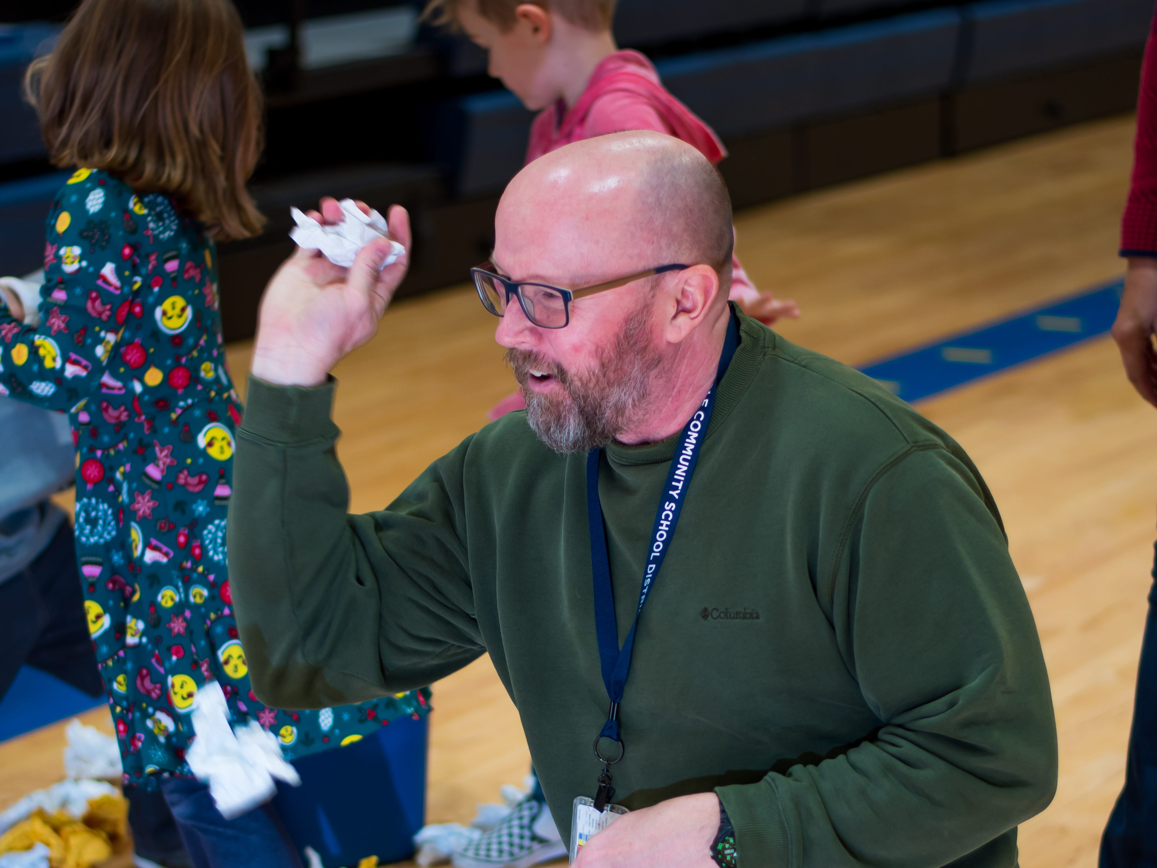 Scott Hunt, of Urbandale plays a snowball game on Friday, Dec. 21, 2018 at Karen Acres Elementary School in Urbandale for their winter party.
