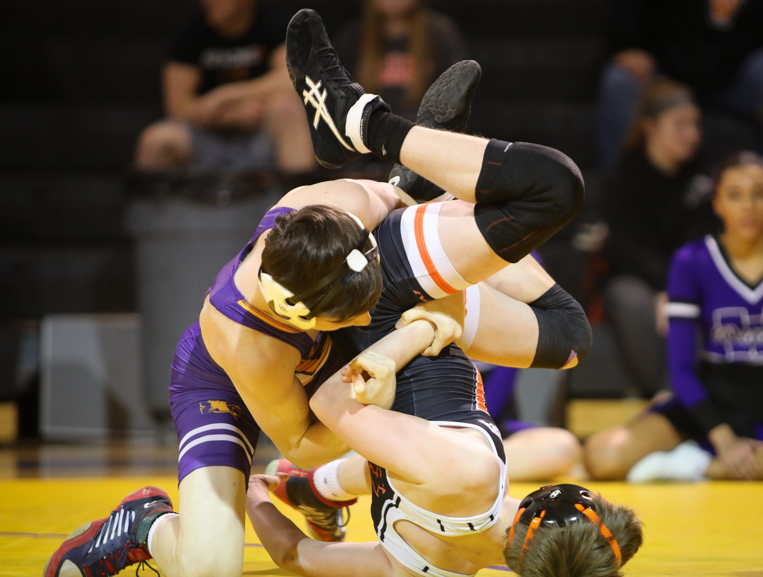 Waukee Thurman Christensen wrestles with Valley sophomore Dylan Fallacaro in the 113-pound weight class during a high school wrestling meet between the Valley Tigers and the Waukee Warriors at Waukee High School on Dec. 20, 2018 in Waukee, Iowa.