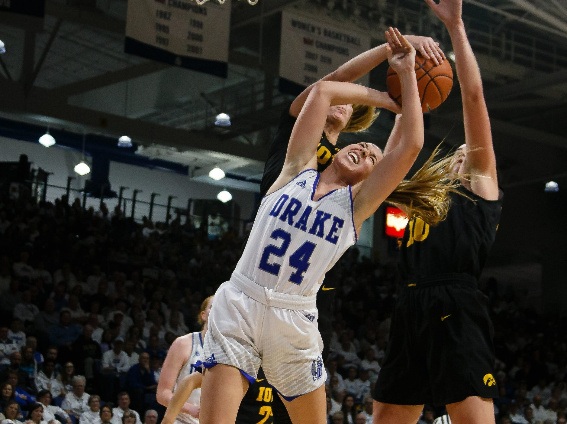 Drake's NicoleÊMiller (24) is fouled as she goes up for a shot during their basketball game on Friday, Dec. 21, 2018, in Des Moines. Iowa would go on to defeat Drake 91-82.