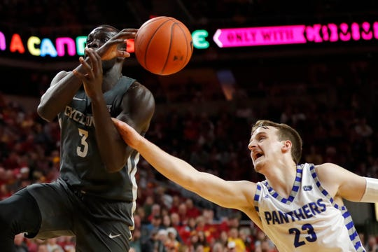 Iowa State guard Marial Shayok is fouled by Eastern Illinois guard Ben Harvey, right, while driving to the basket during the second half of an NCAA college basketball game Friday, Dec. 21, 2018, in Ames, Iowa. Iowa State won 101-53.