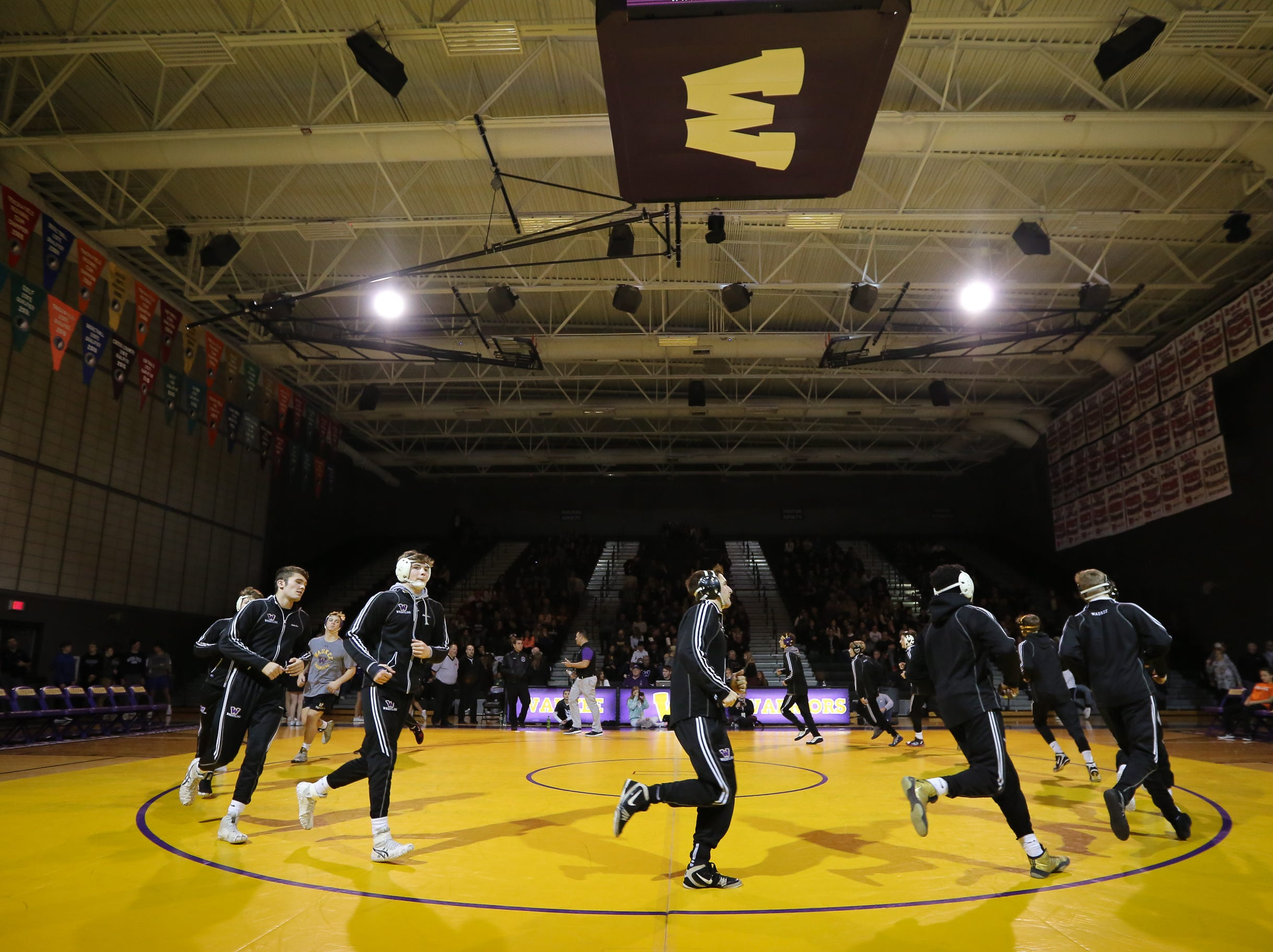 The Waukee Warriors wrestling team takes the mat before a high school wrestling meet against the Valley Tigers at Waukee High School on Dec. 20, 2018 in Waukee, Iowa.