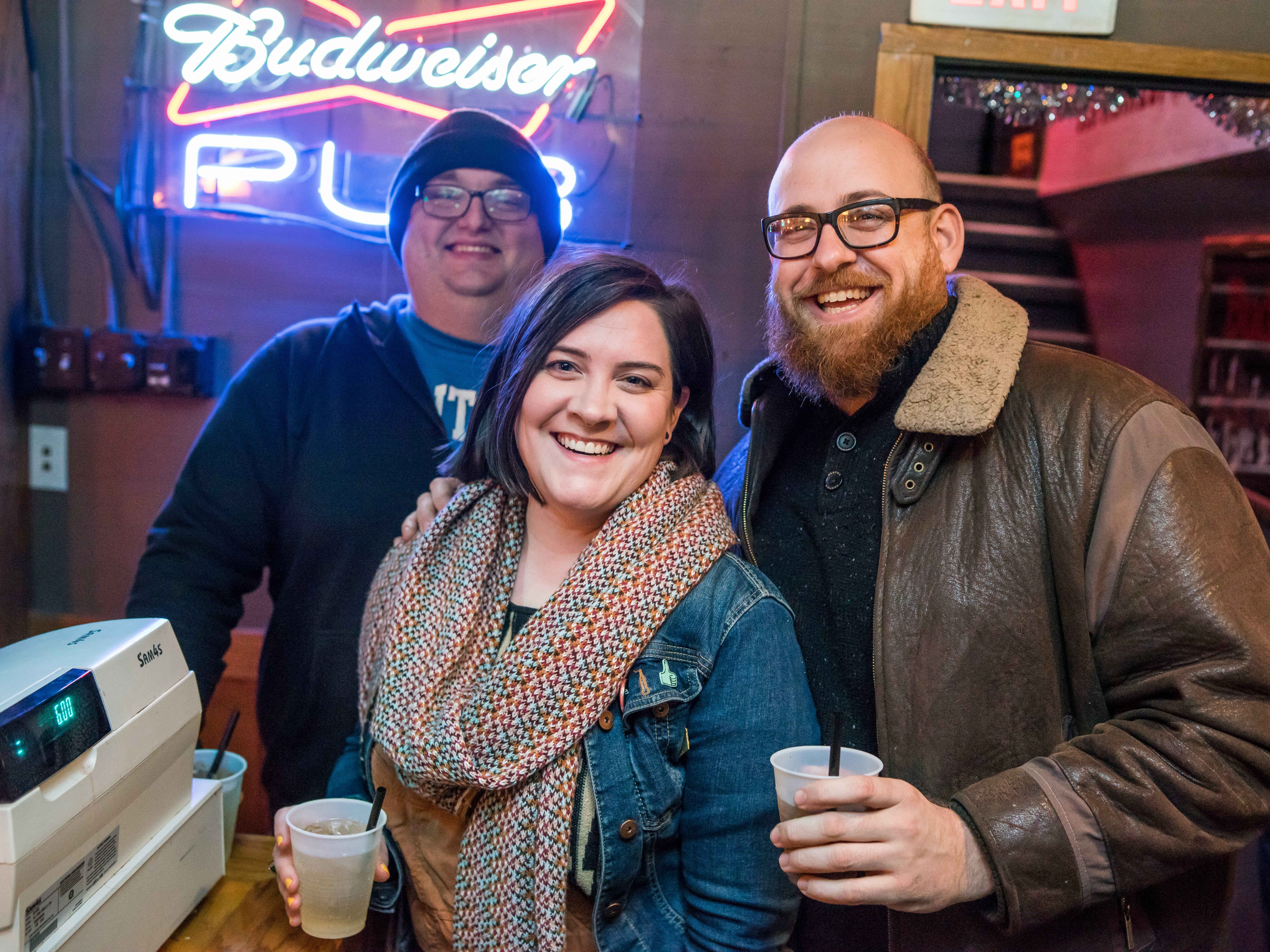 Mike Kitzman, 32, Erin Johnson, 30, and Will Frazier, 37, all of Des Moines, having some laughs, Friday, Friday, Dec. 21, at the Bomb Shelter Comedy Showcase, hosted by the Beechwood.