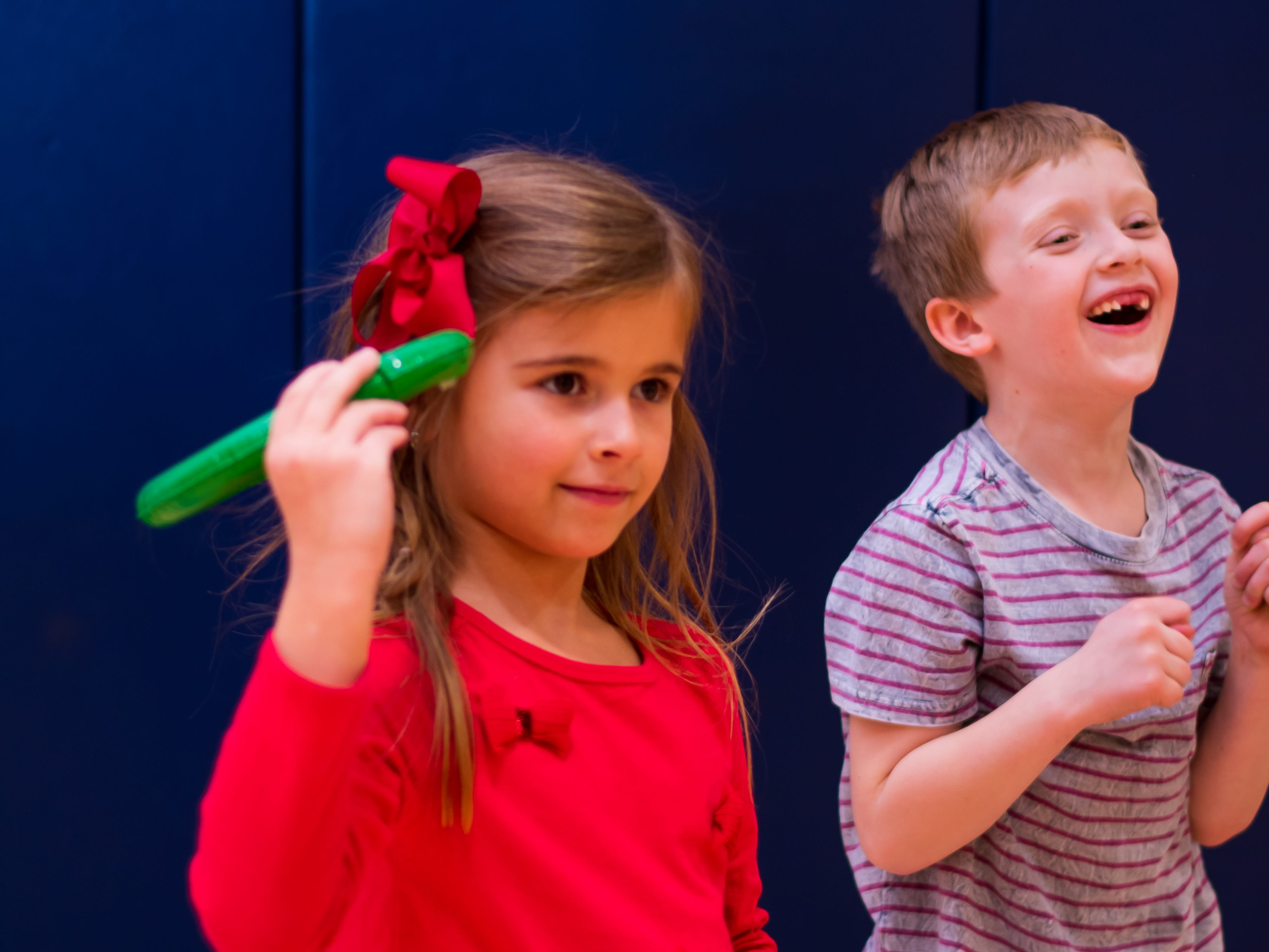 Melina Beslagic, 6, and Aiden Torpy, 6, both of Urbandale play a game on Friday, Dec. 21, 2018 at Karen Acres Elementary School in Urbandale for their winter party.