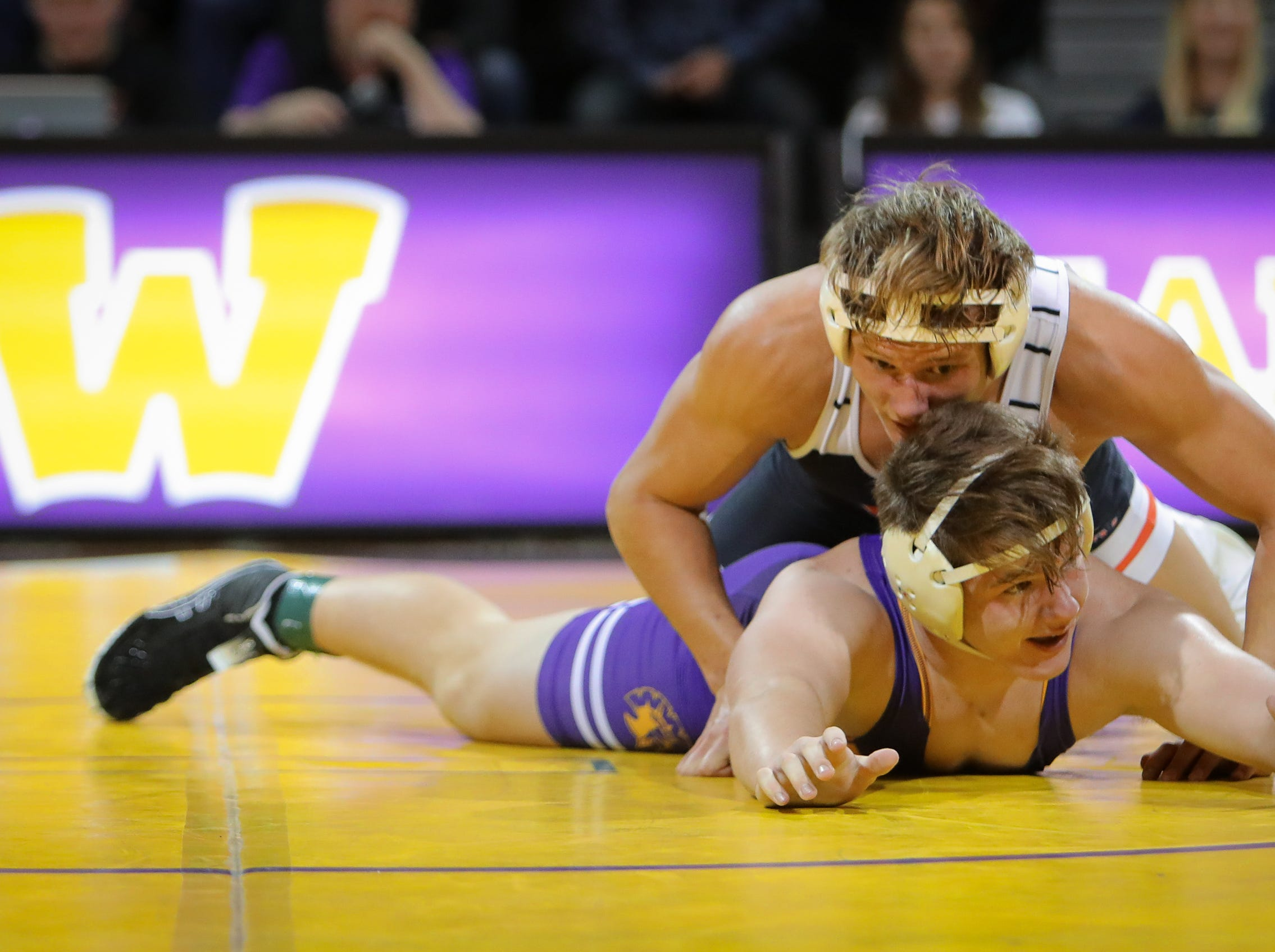 Valley junior Blake Underwood holds down Waukee freshman Griffin Gammell airborne in the 182-pound weight class during a high school wrestling meet between the Valley Tigers and the Waukee Warriors at Waukee High School on Dec. 20, 2018 in Waukee, Iowa.