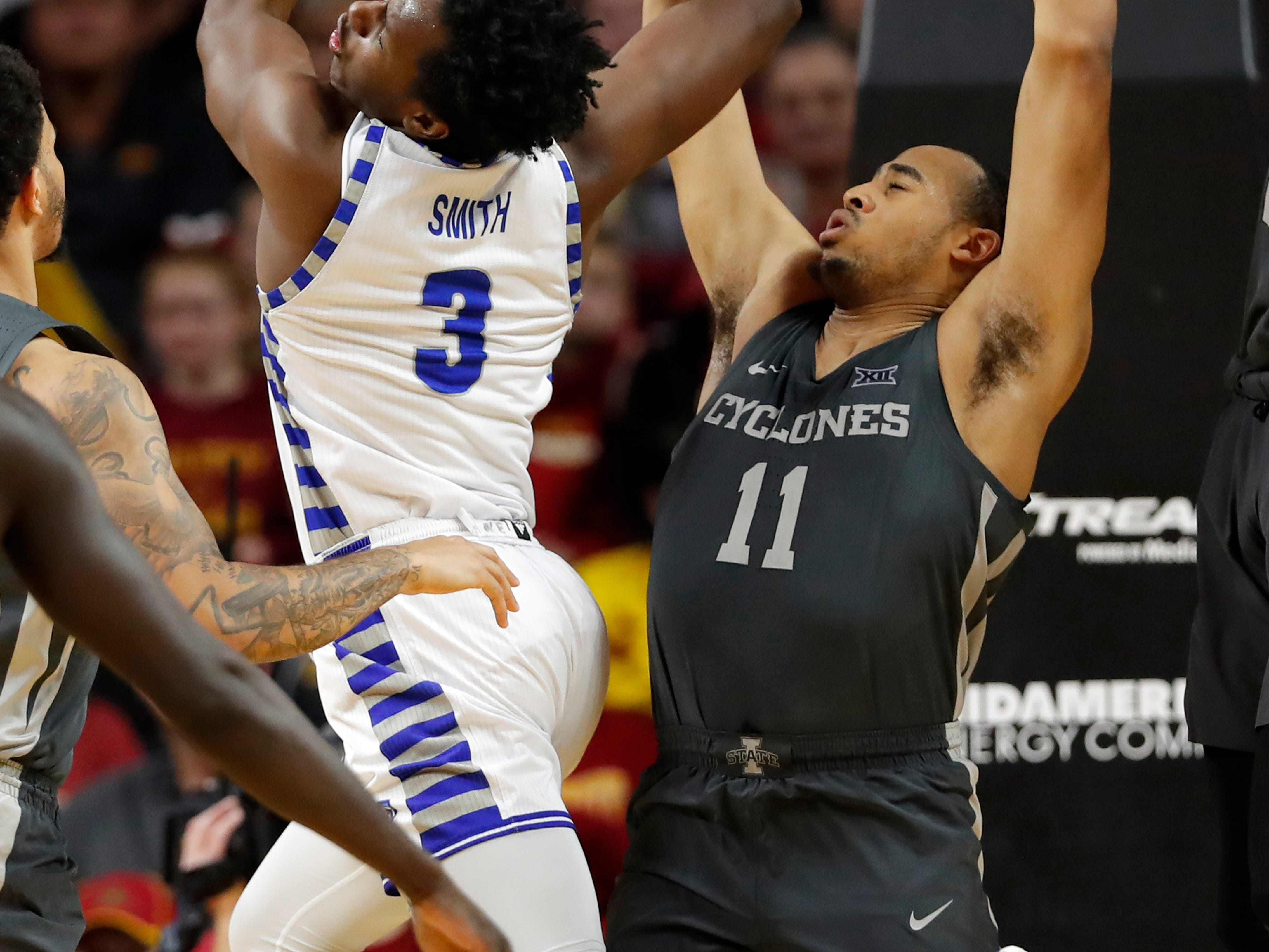 Eastern Illinois guard Mack Smith (3) loses the ball while driving to the basket in front of Iowa State guard Talen Horton-Tucker (11) during the second half of an NCAA college basketball game Friday, Dec. 21, 2018, in Ames, Iowa.