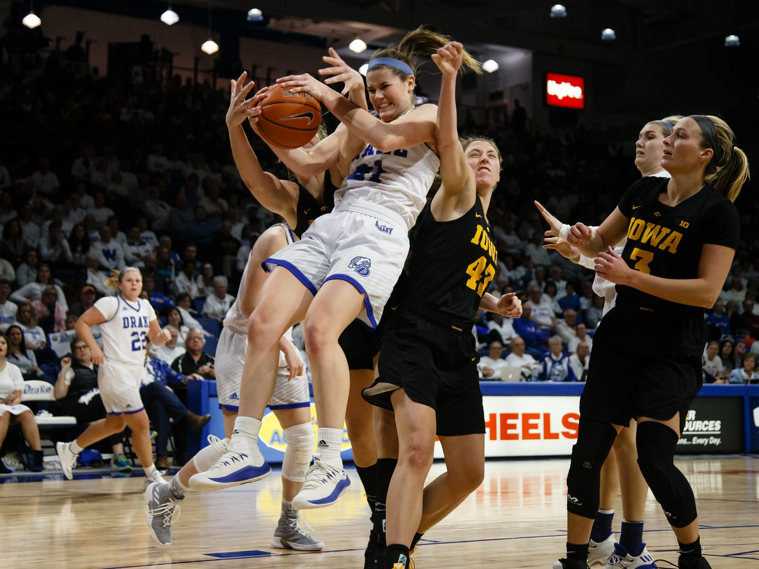 Drake's SammieÊBachrodt (21) comes down with a rebound during their basketball game on Friday, Dec. 21, 2018, in Des Moines. Iowa would go on to defeat Drake 91-82.