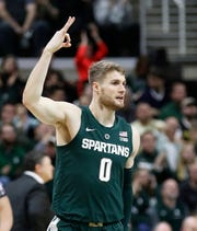 Kyle Ahrens reacts after a 3-point basket against Oakland on Dec. 21, 2018, in East Lansing.