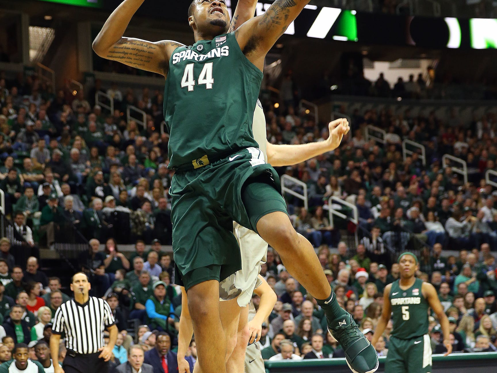 Michigan State Spartans forward Nick Ward (44) lays the ball up against the Oakland Golden Grizzlies during the second half of a game at the Breslin Center.