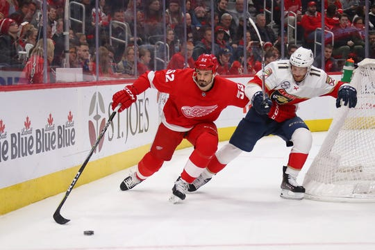 Jonathan Ericsson of the Detroit Red Wings battles for the puck against Jonathan Huberdeau of the Florida Panthers during the first period at Little Caesars Arena on Dec. 22, 2018, in Detroit. (Photo by Gregory Shamus/Getty Images)